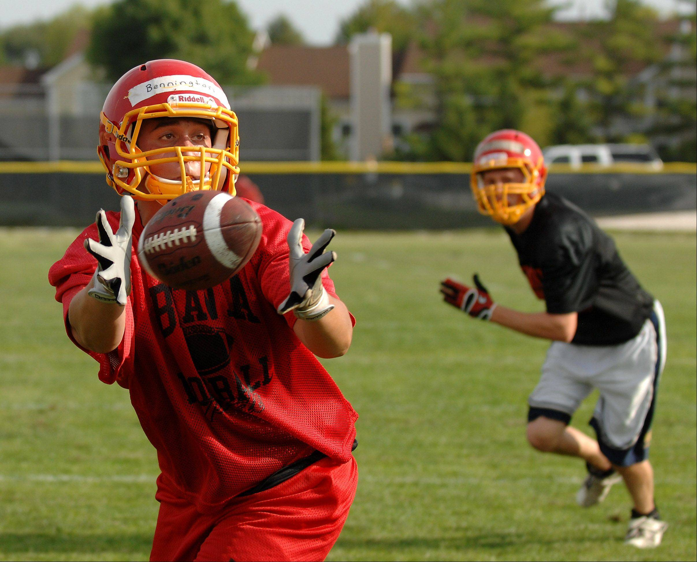 Ben Bennington reaches out to make a grab during Batavia's first day of football practice Wednesday.