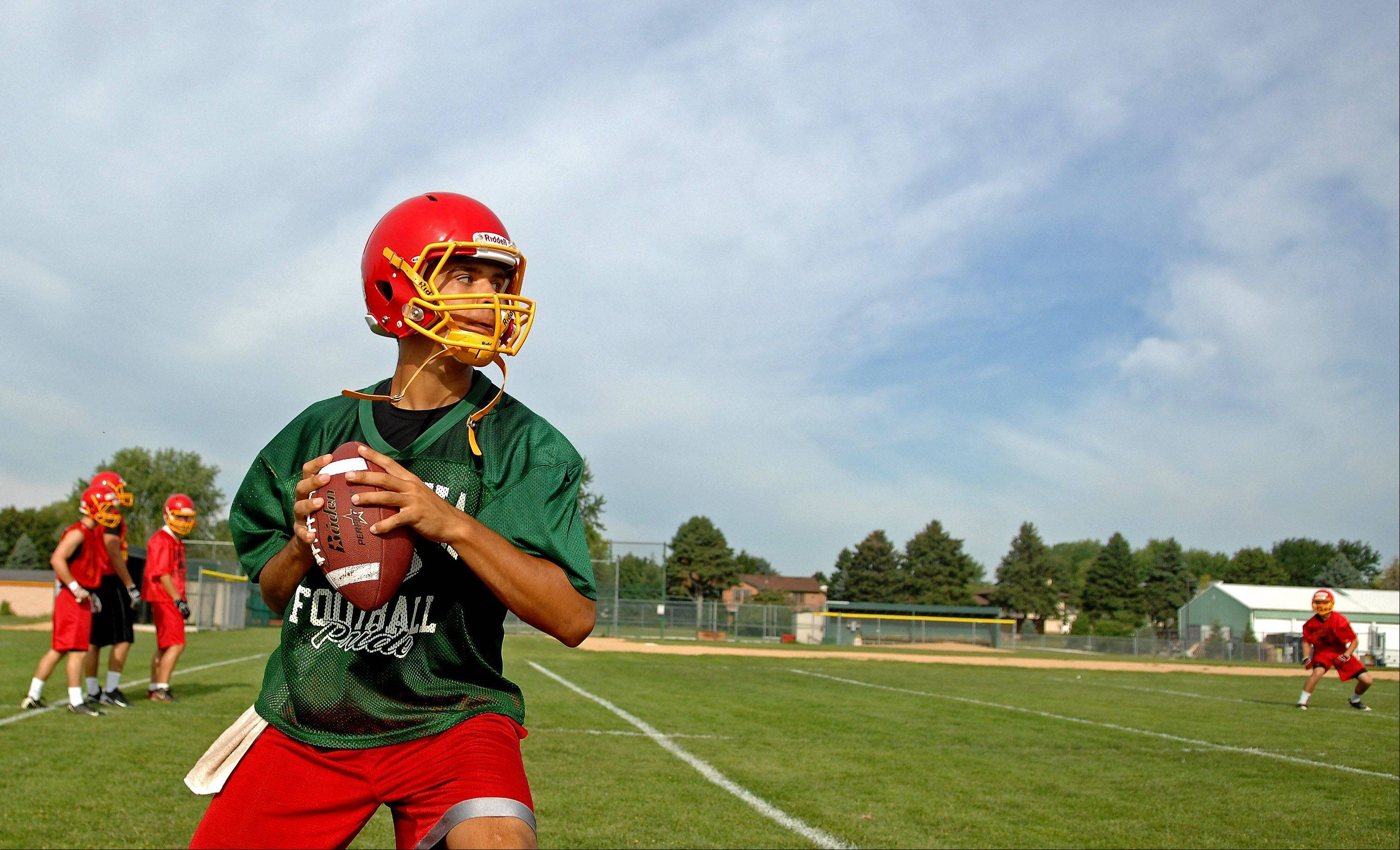 Quarterback Micah Coffey looks downfield for a receiver during Batavia's first day of football practice Wednesday.