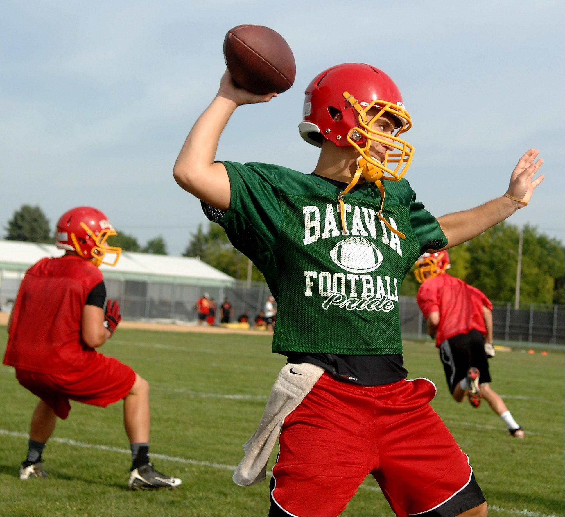Quarterback Daniel Albrecht rears back to pass during Batavia's first day of football practice Wednesday.