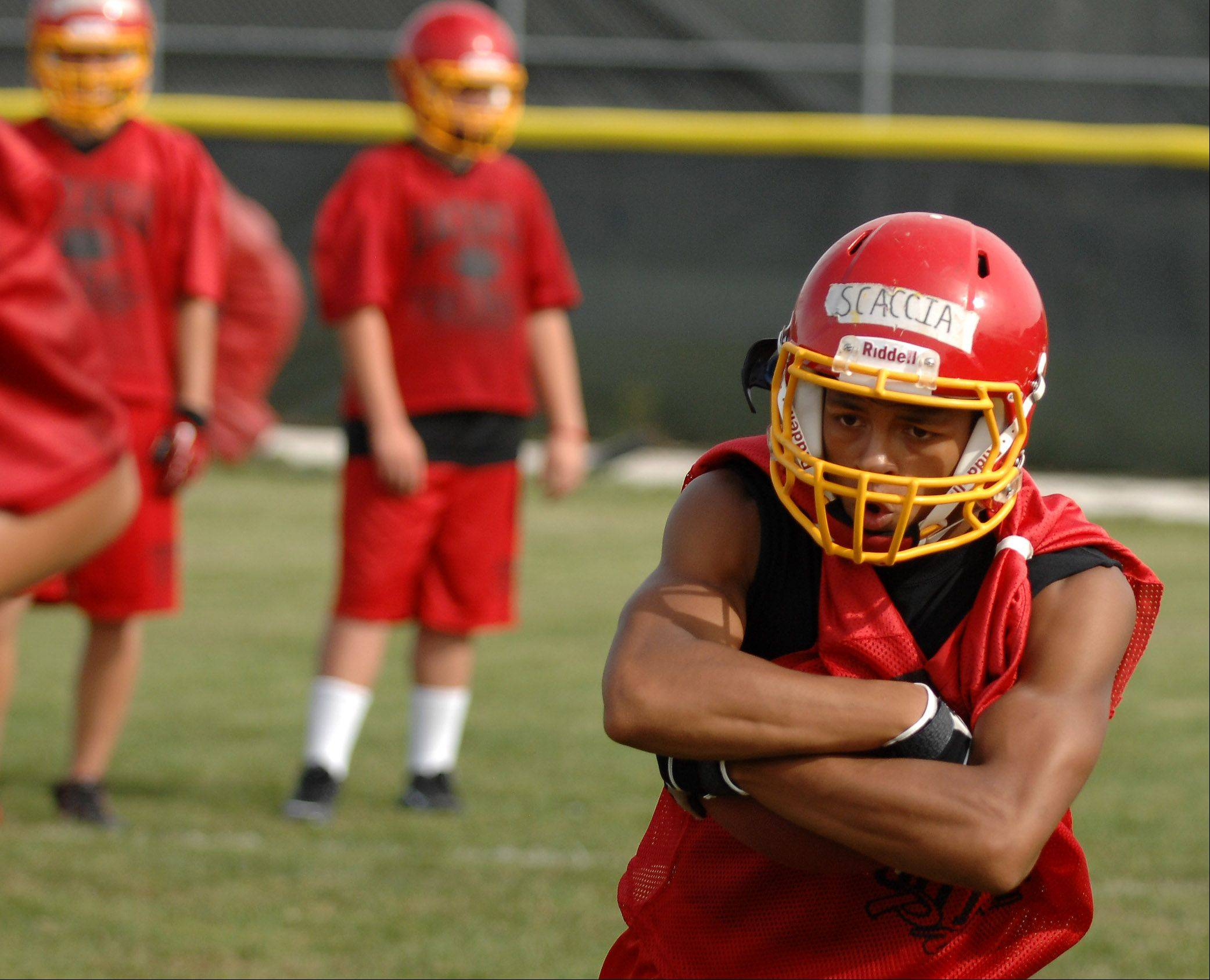 Running back Anthony Scaccia hits the hole during Batavia's first day of football practice Wednesday.