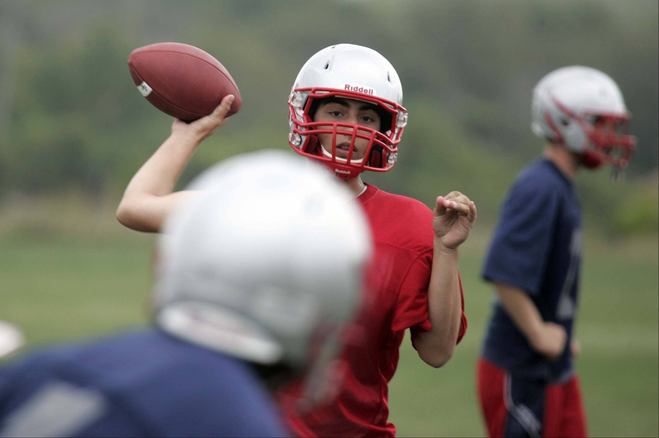 Joe Balaja looks for an open reciever during the first day of football practice at South Elgin on Wednesday.
