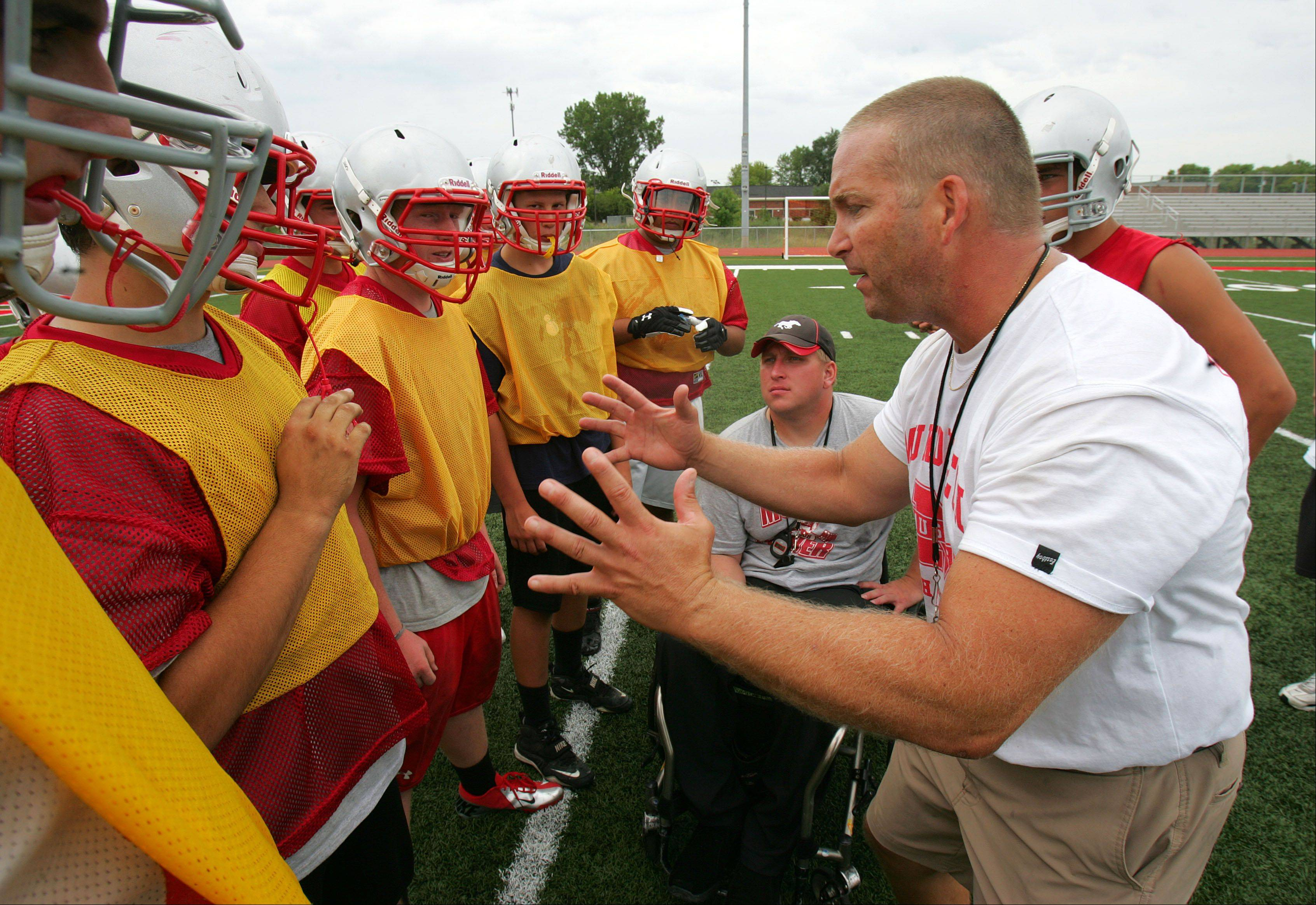 Mundelein coach George Kaider runs practice Wednesday afternoon in Mundelein.