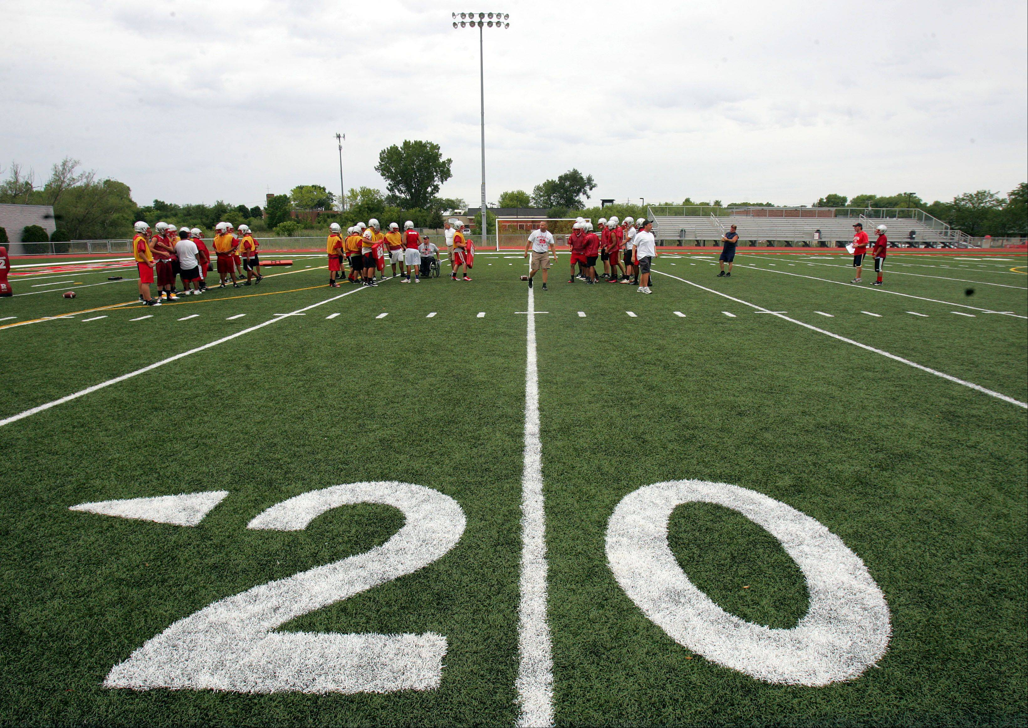 The Mundelein football team practices on its new surface Wednesday afternoon.