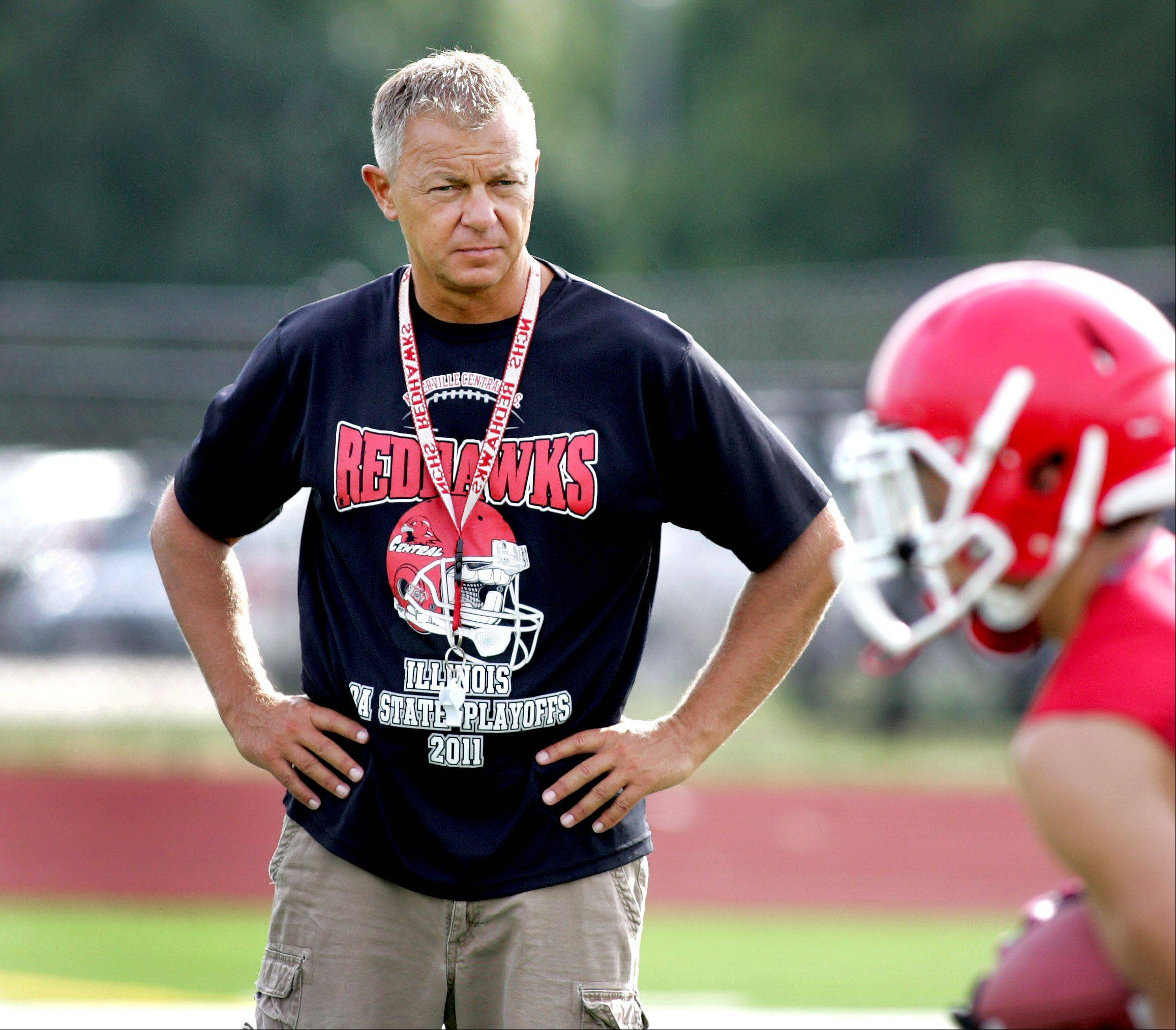 Coach Mike Stine watches practice at Naperville Central High School on Wednesday.
