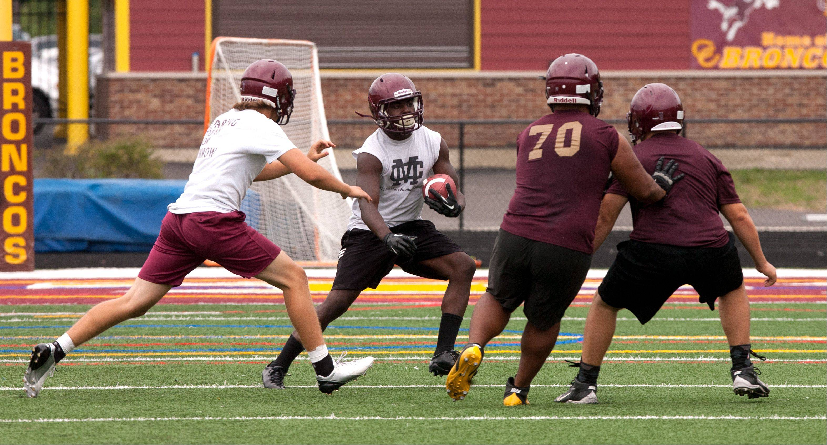 Montini Catholic's Dimitri Taylor practices during a punt drill.
