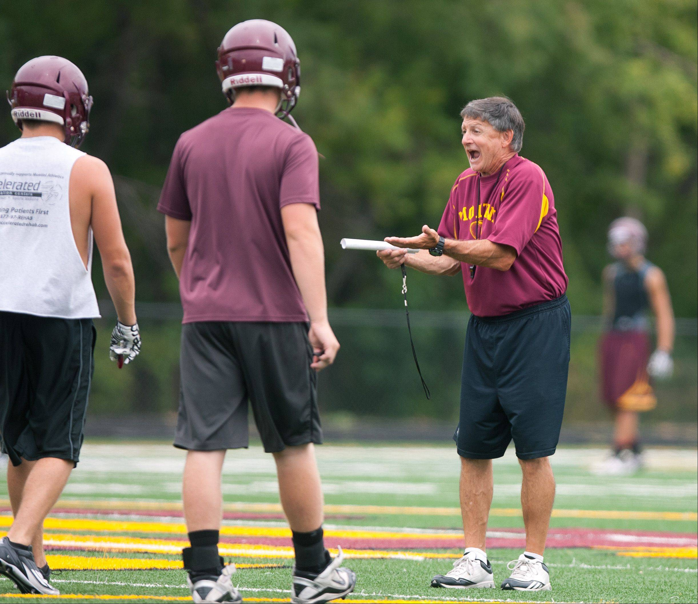 Montini Catholic football coach Chris Andriano works with his team.