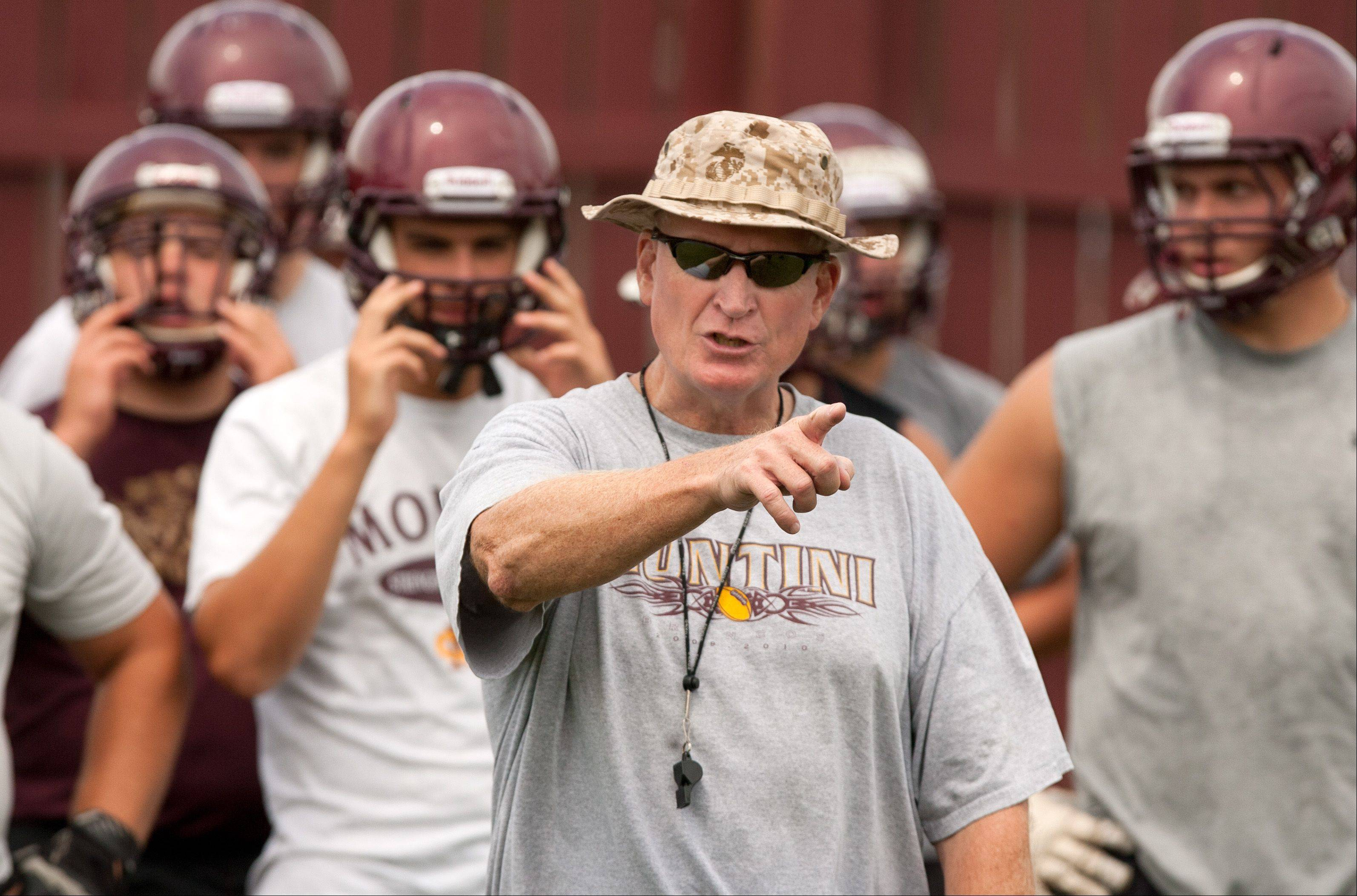 Montini Catholic offensive line coach Mark Placey practices with the Broncos.