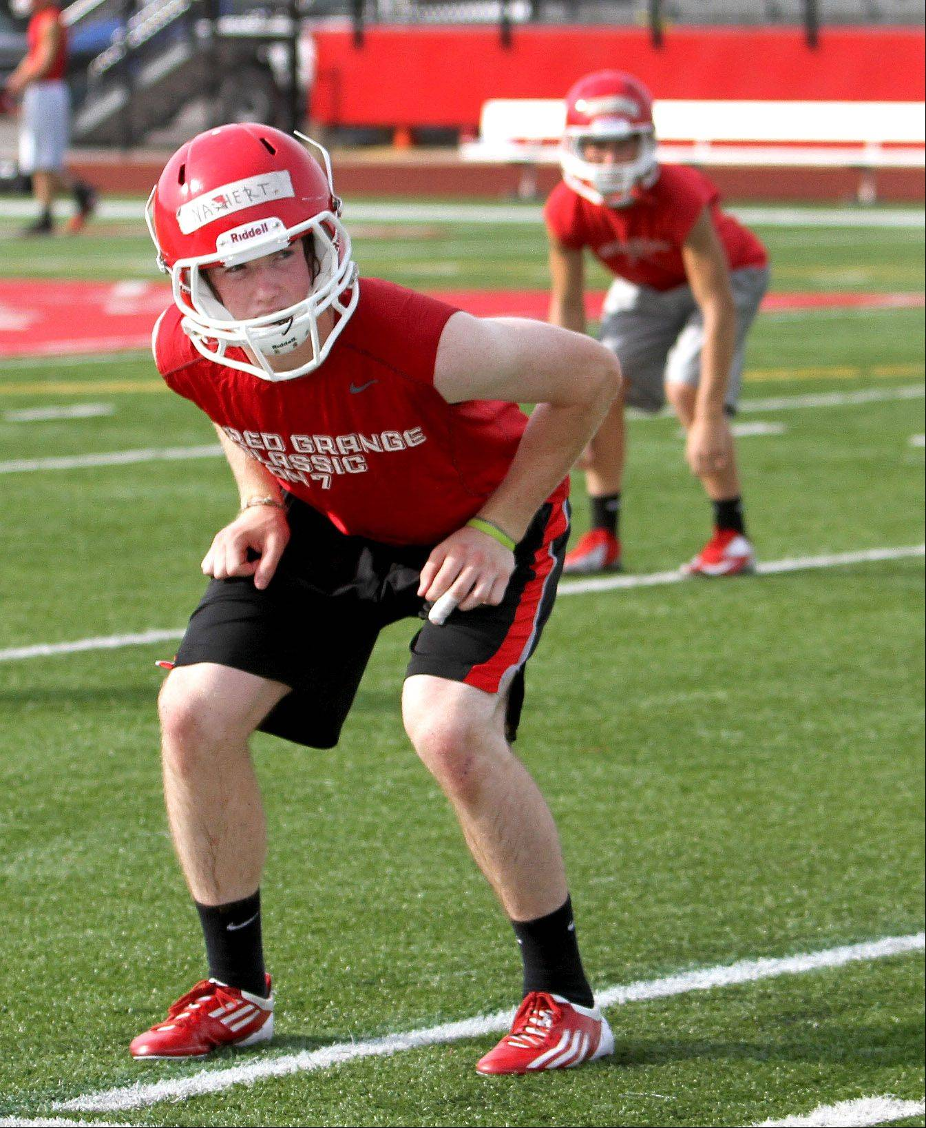 Jimmy Nashert goes through drills with his team at Naperville Central High School on Wednesday.