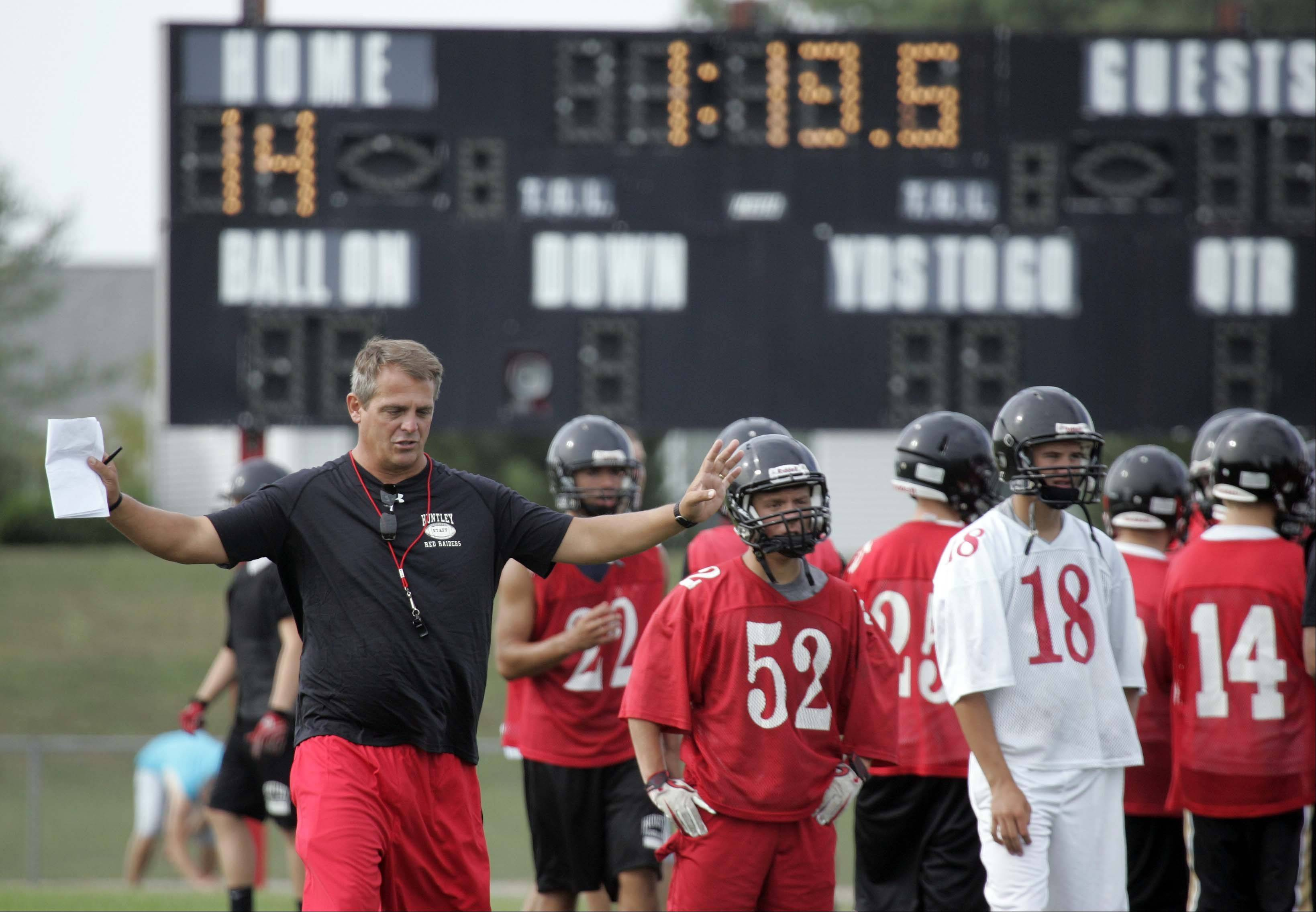 New coach John Hart works with his athletes at Huntley High School.