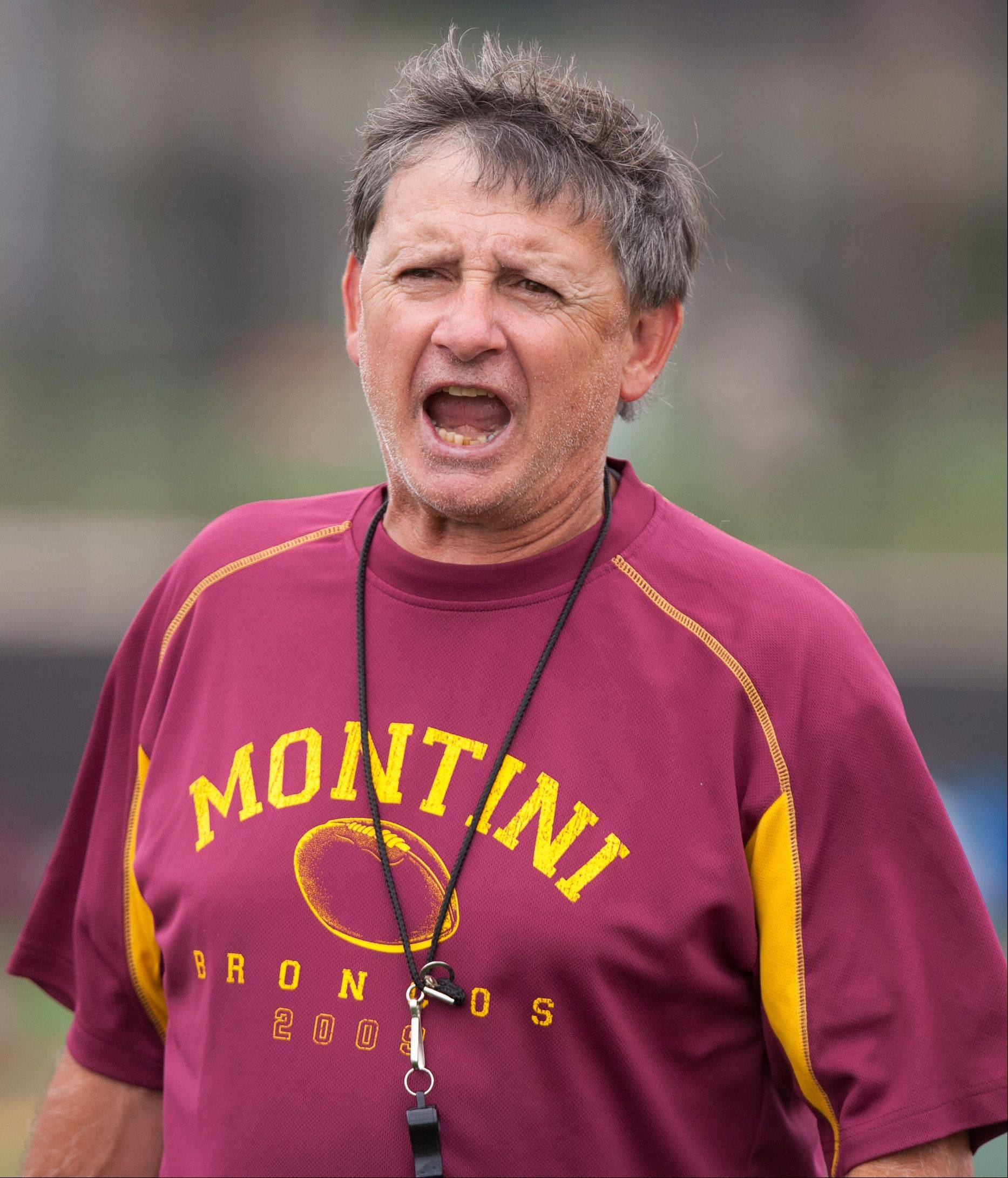 Montini Catholic football coach Chris Andriano runs practice on Wednesday.