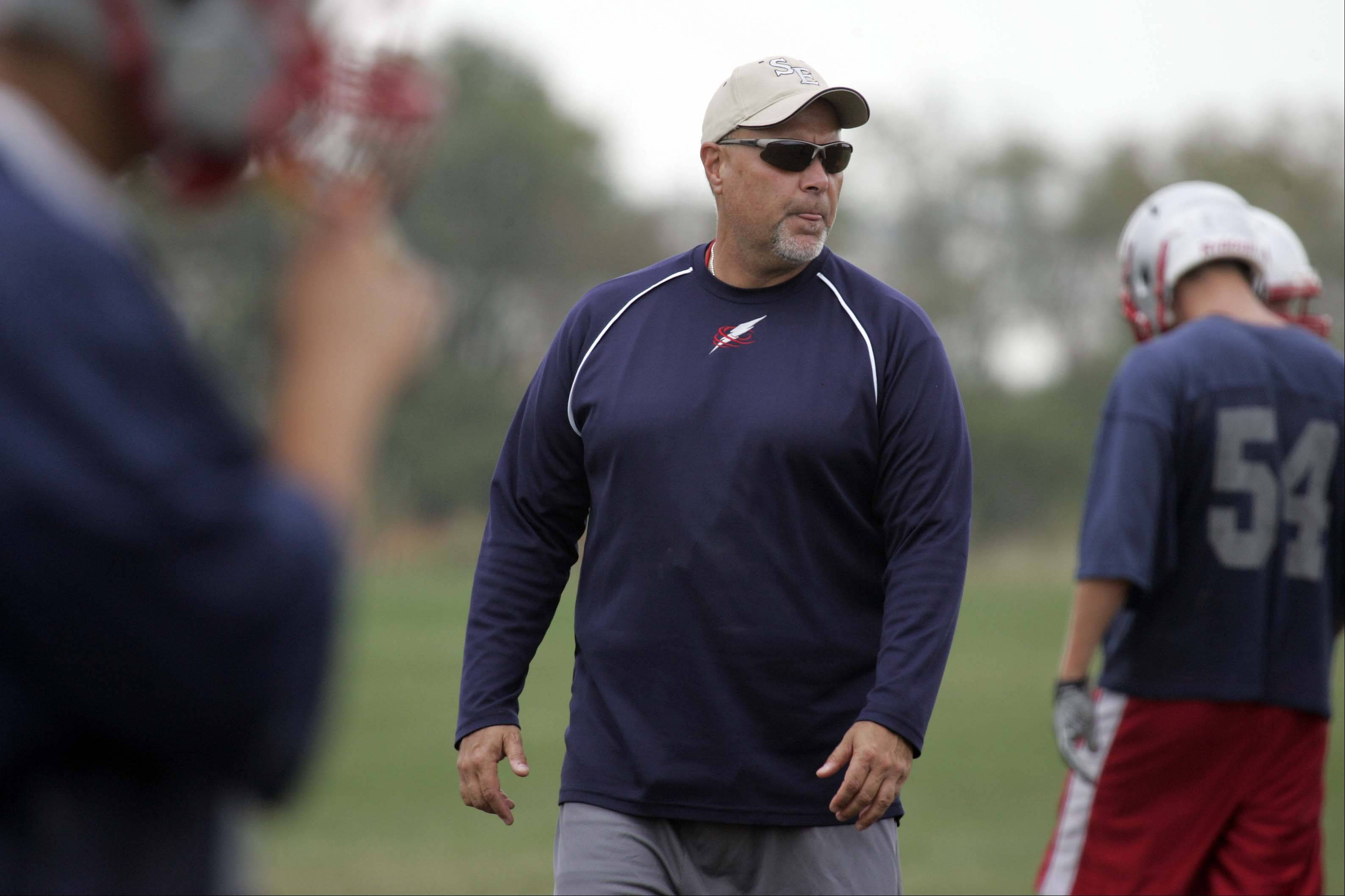 Coach Dale Schabert works with his team at South Elgin High School.