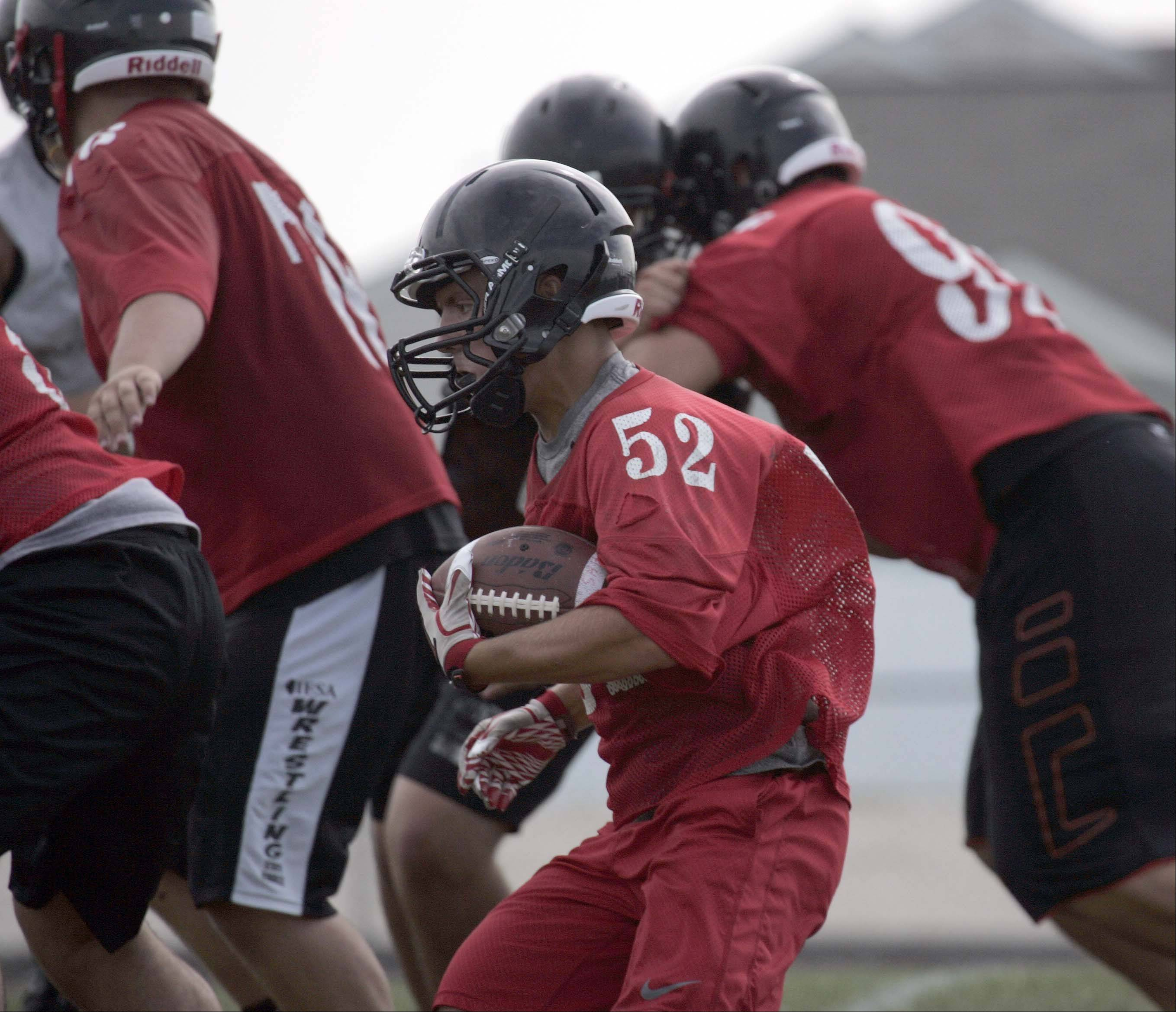 Jake Scalice looks for an opening during practice at Huntley High School.