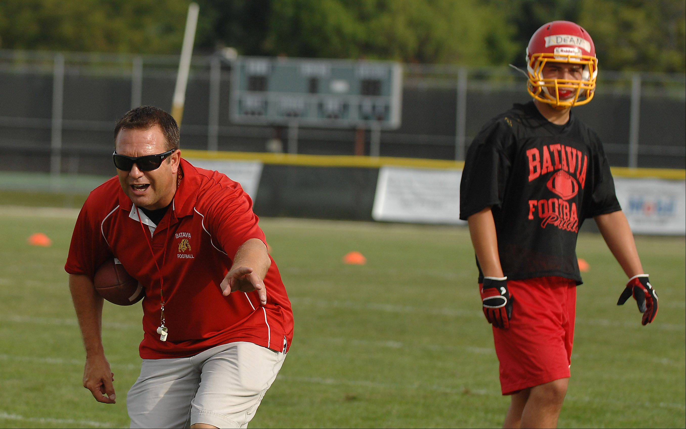 Head coach Dennis Piron directs his team during Batavia's first day of football practice Wednesday.