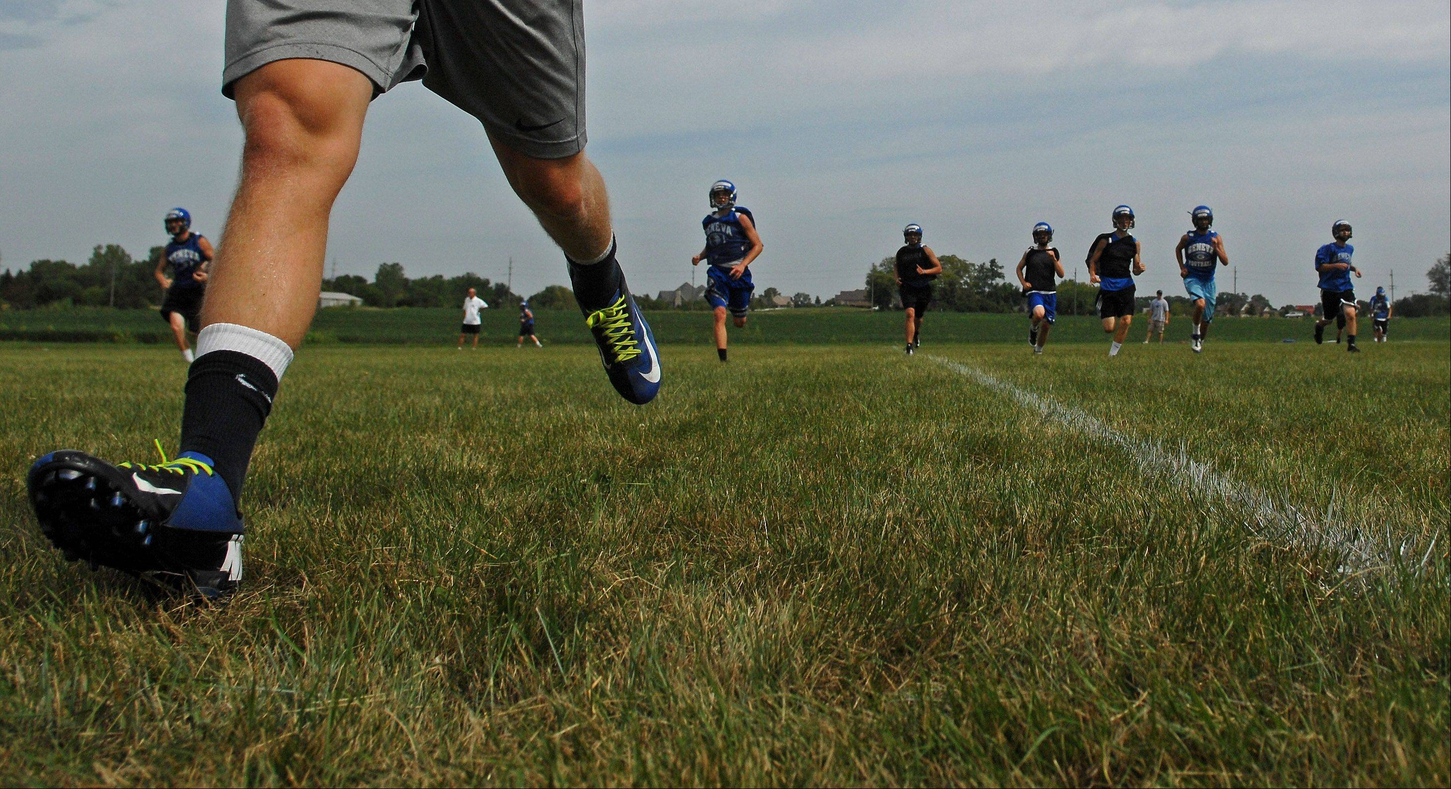 Players run sprints during Geneva's first day of football practice in LaFox Wednesday.