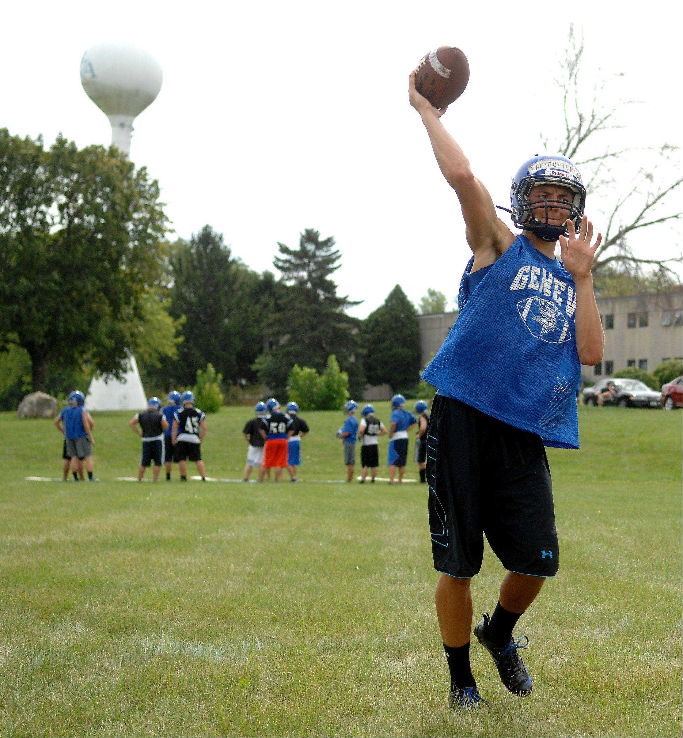 Quarterback Daniel Santacaterina makes a throw during Geneva's first day of football practice in LaFox Wednesday.