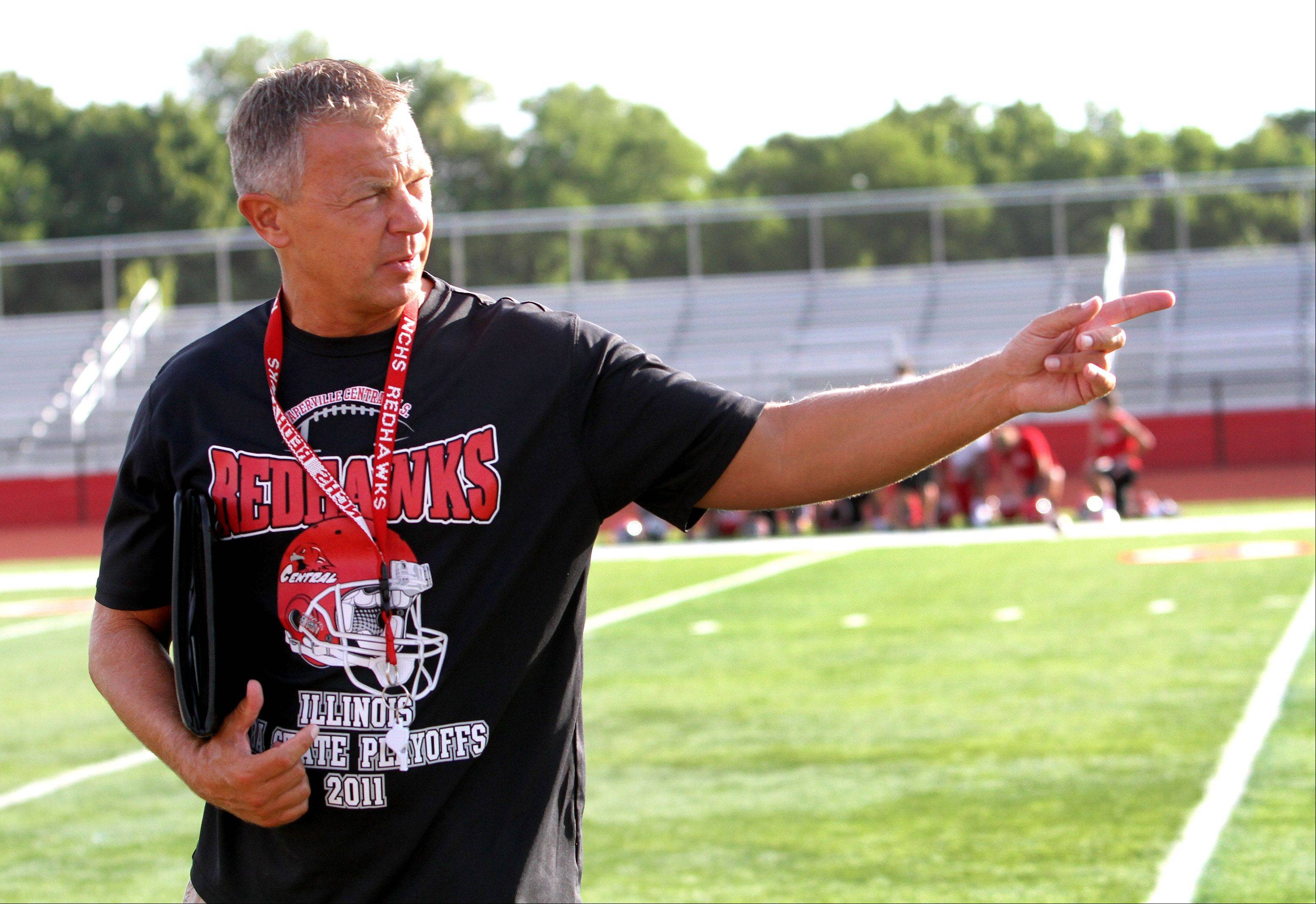 Coach Mike Stine watches a play at Naperville Central High School on Wednesday.