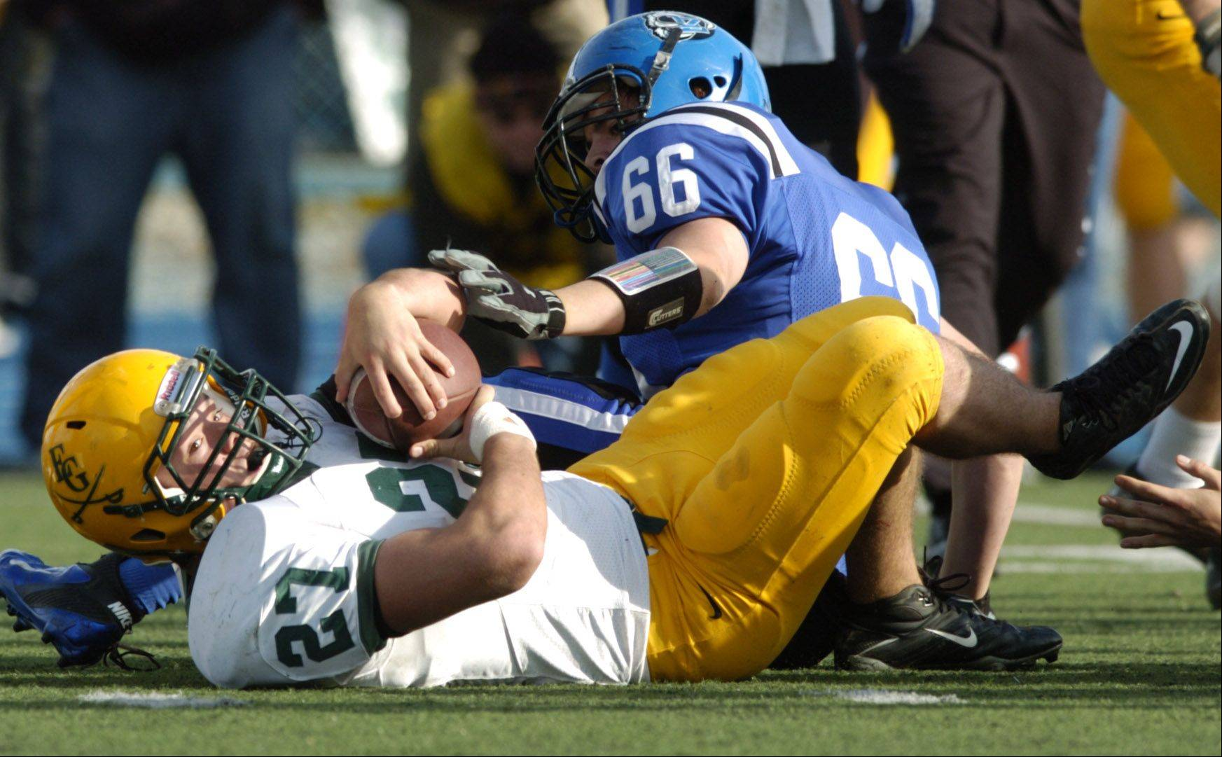 Elk Grove and linebacker Mike Maize are trying to retain possession of the Mid-Suburban East title.