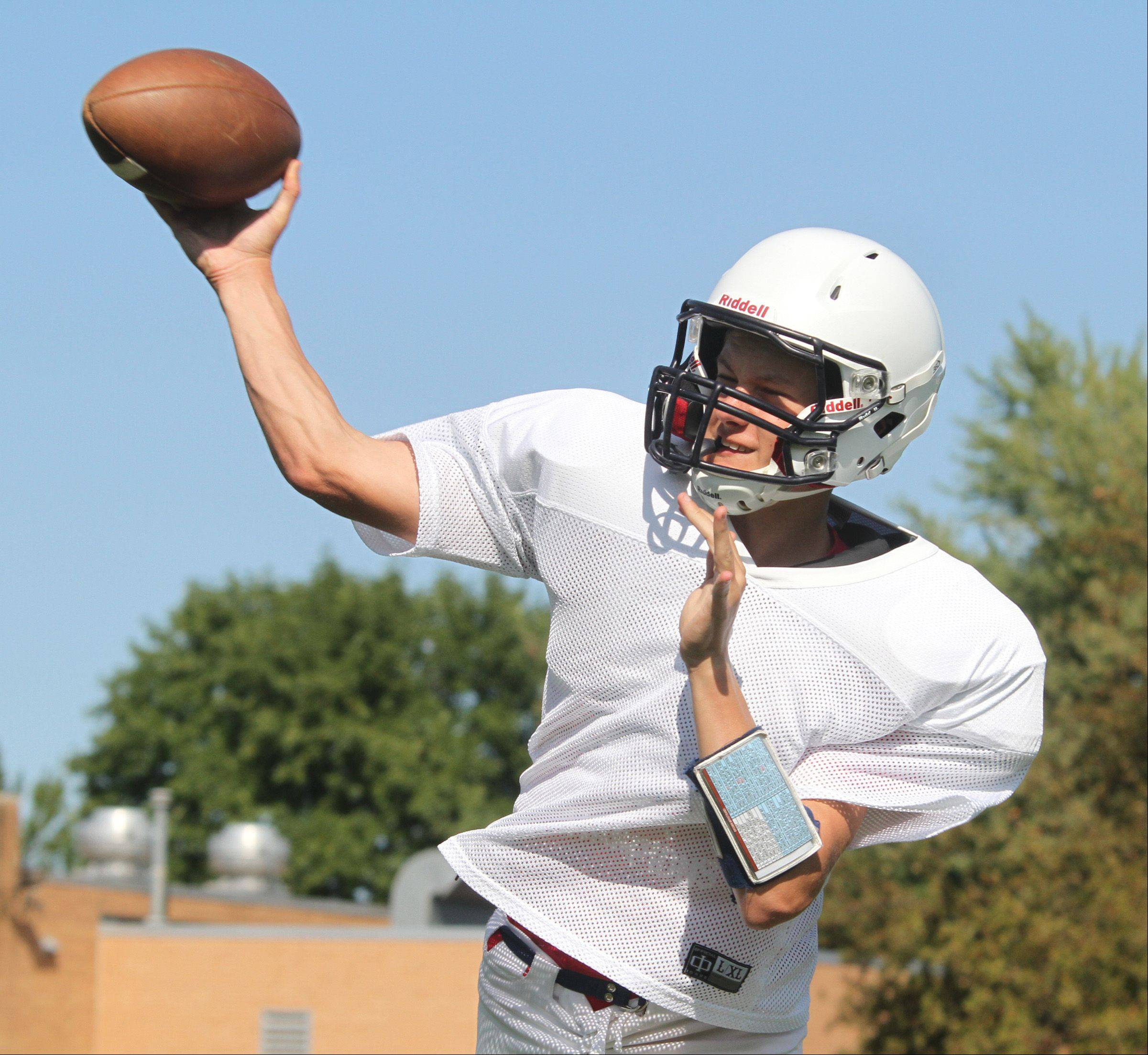 St. Viator quarterback Bob Calmeyn delivers during practice on Tuesday.