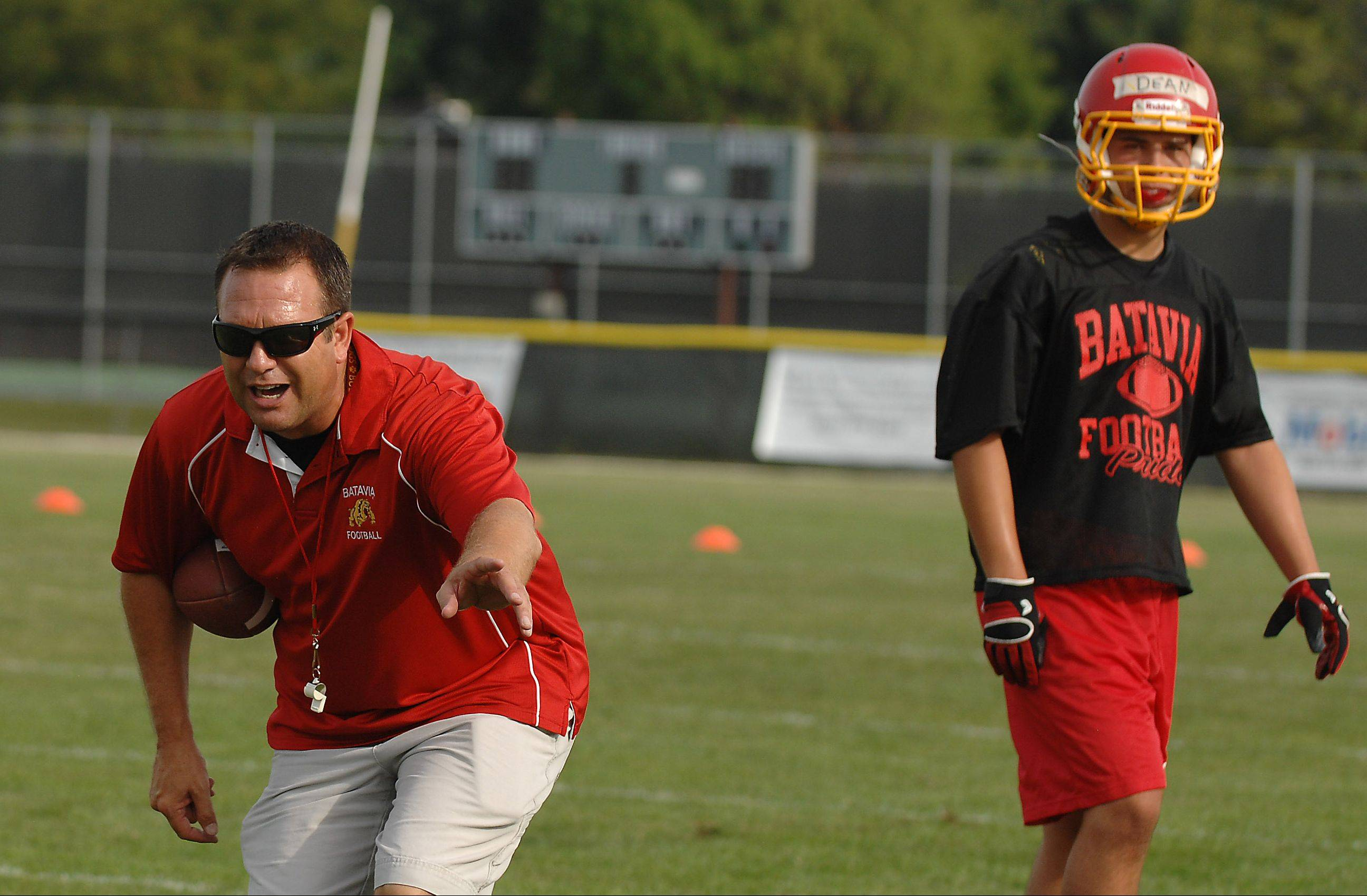 Head coach Dennis Piron directs his team during Batavia's first day of football practice.