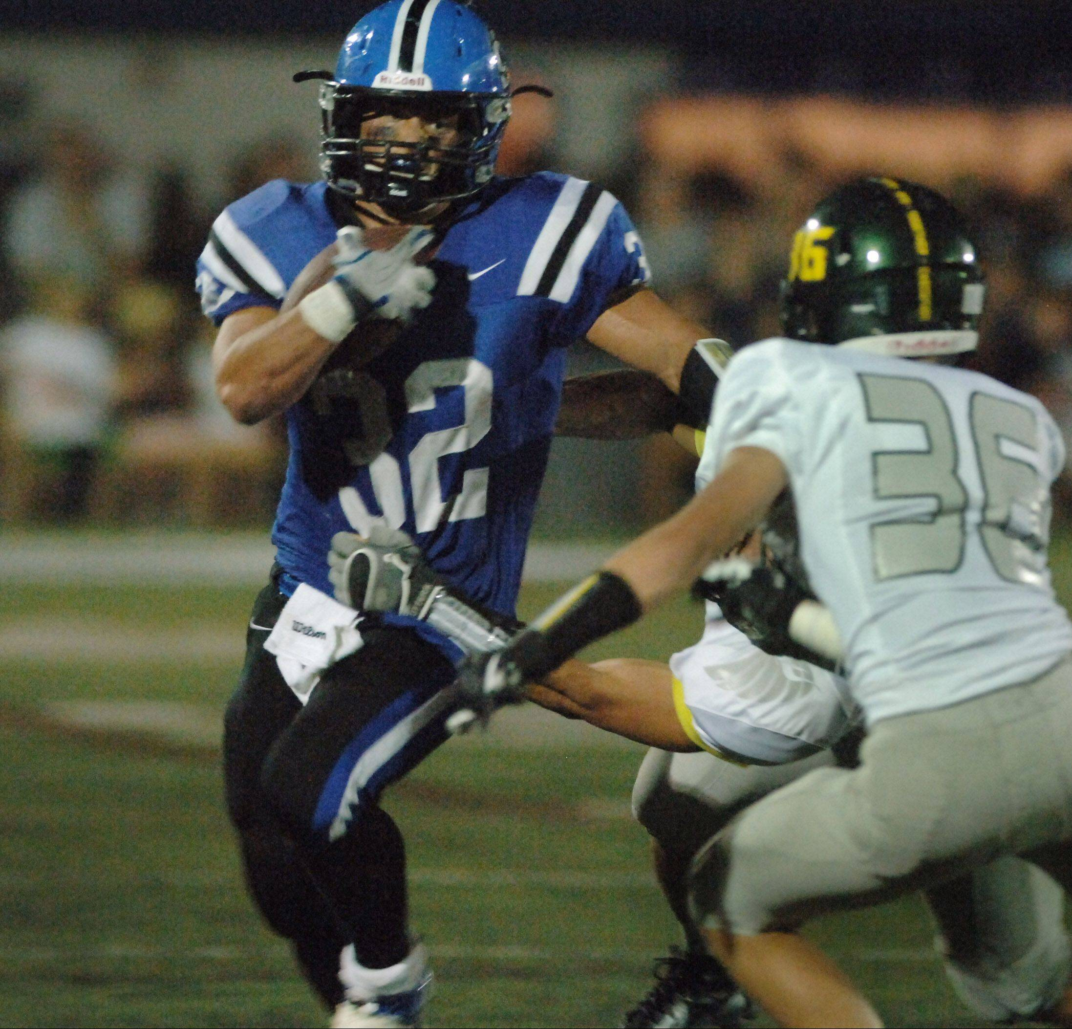 Lake Zurich's Connor Schrader looks for some running room against Fremd on Friday night in Lake Zurich.