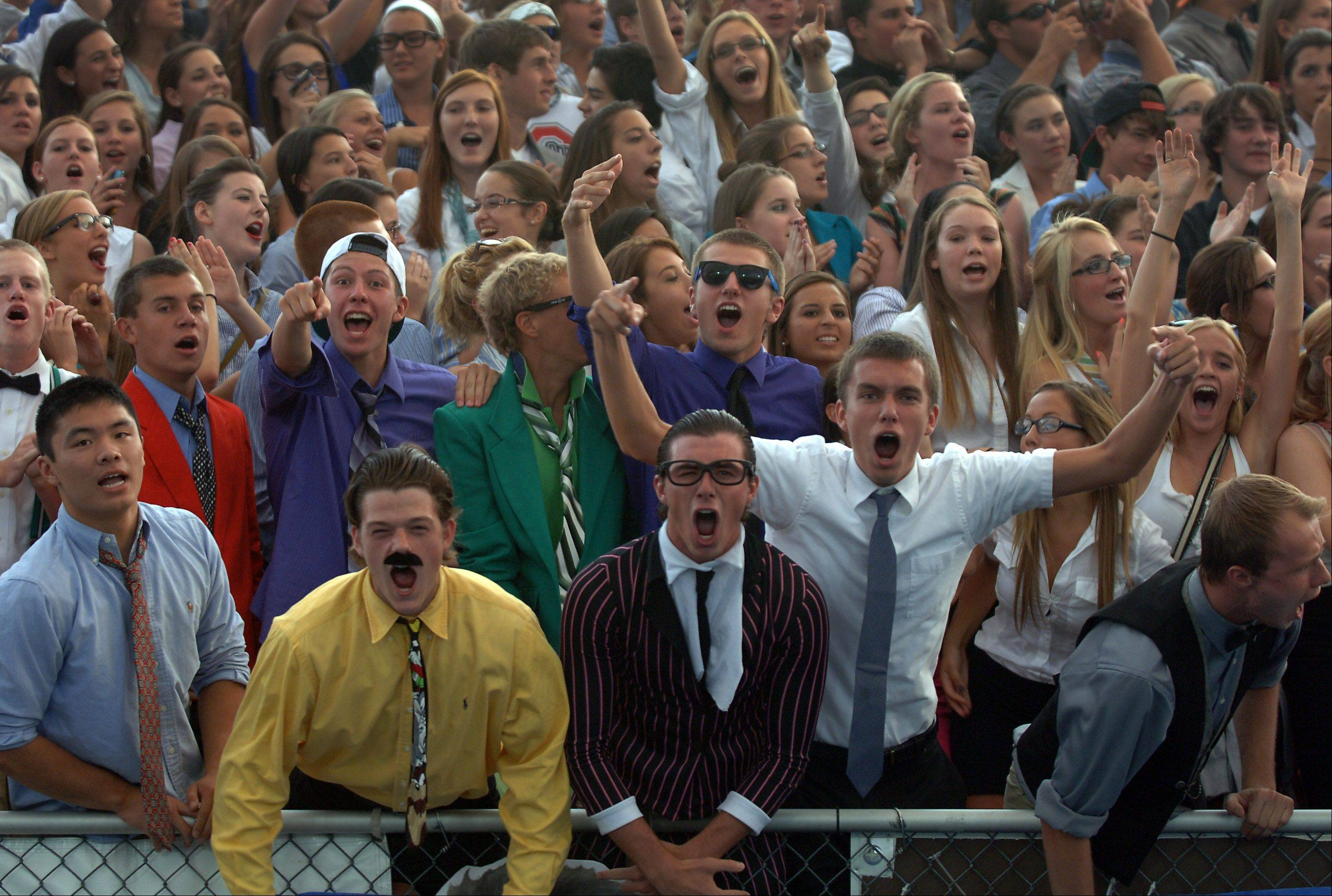 Lake Zurich fans cheer on their teams as the Bears take the field Friday night in Lake Zurich.