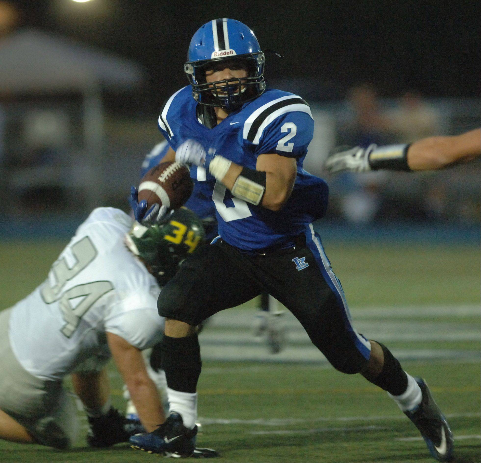 Lake Zurich's Kody Schaar looks for a hole during Friday night's home game against Fremd.
