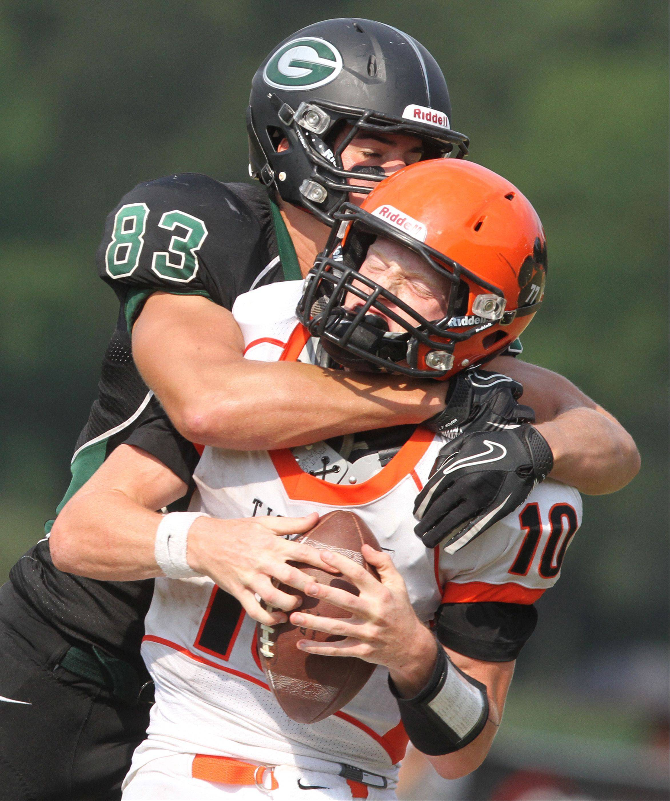 George LeClaire/gleclaire@dailyherald.comGlenbard West tight end Nathan Marcus sacks Wheaton Warrenville South quarterback Ryan Graham in the third-quarter on fourth down with 13-yards to go at Glenbard West on Saturday, August 25.