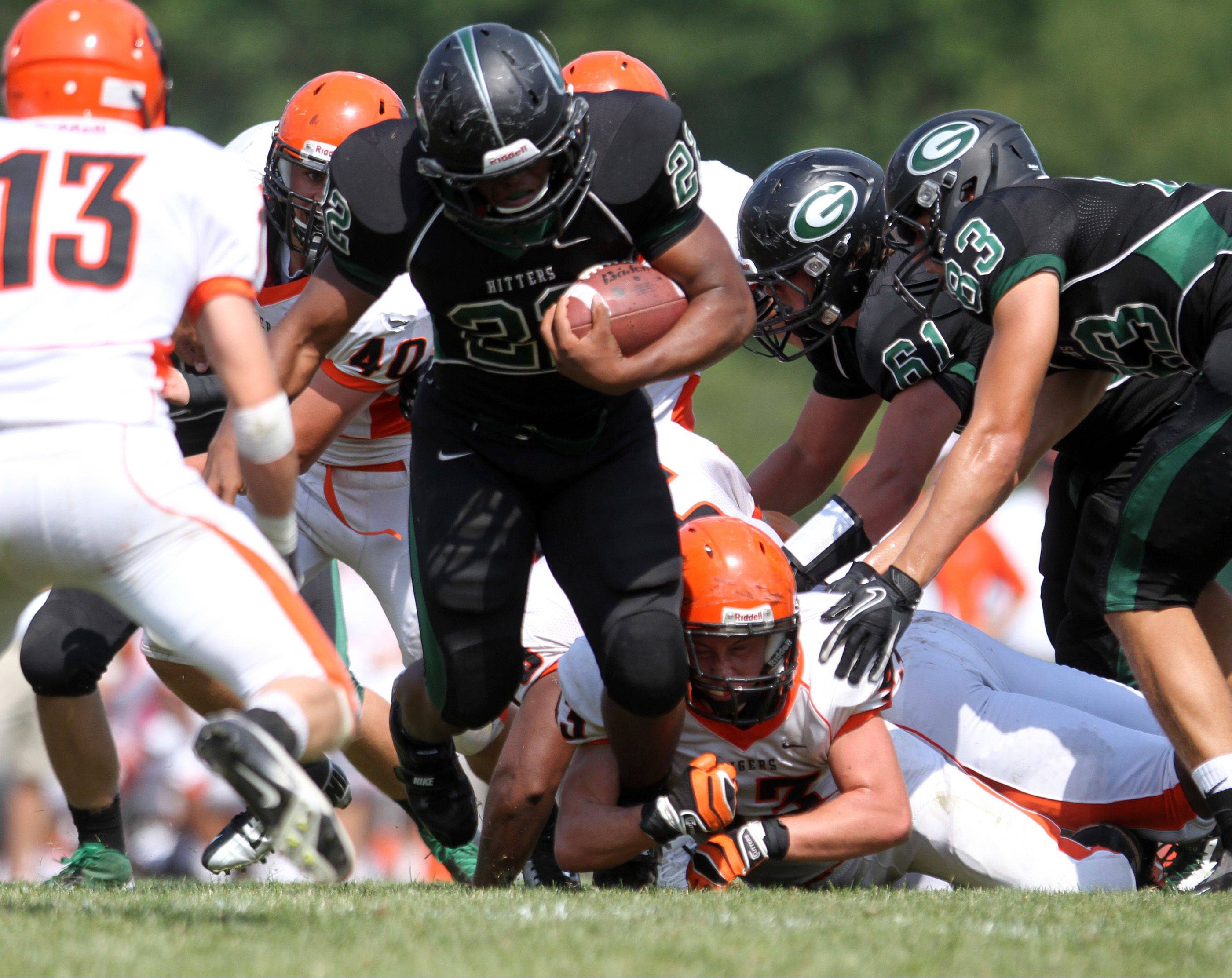 Glenbard West running back Devante Toney runs up the middle against Wheaton Warrenville South at Glenbard West on Saturday, August 25.