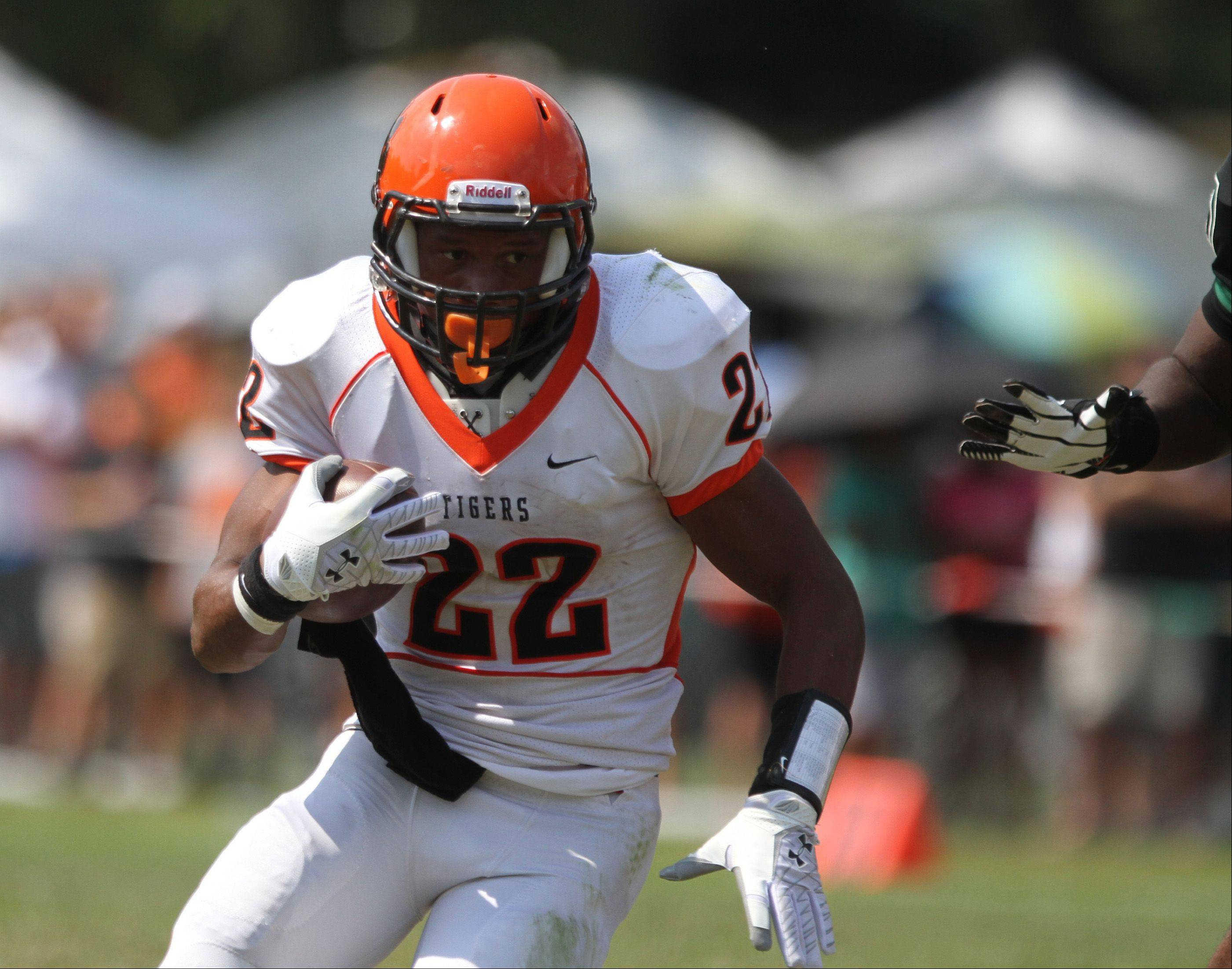 Wheaton Warrenville South running back Brandon Adams runs with the ball at Glenbard West on Saturday, August 25.
