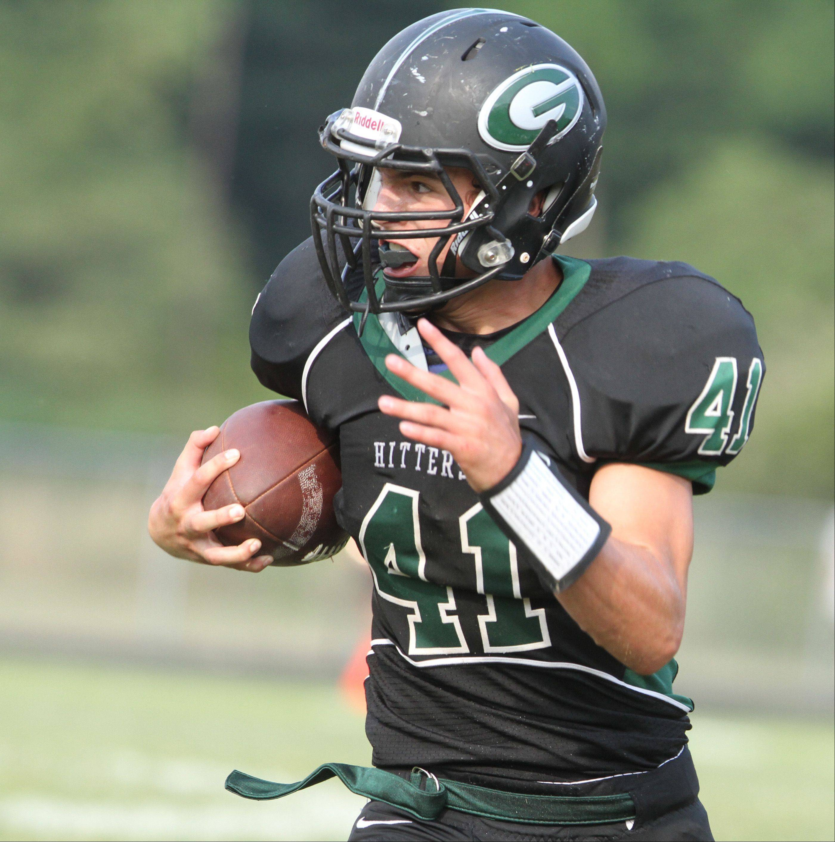 Glenbard West linebacker Eric Farley runs with an interception in the third-quarter against Wheaton Warrenville South at Glenbard West on Saturday, August 25.