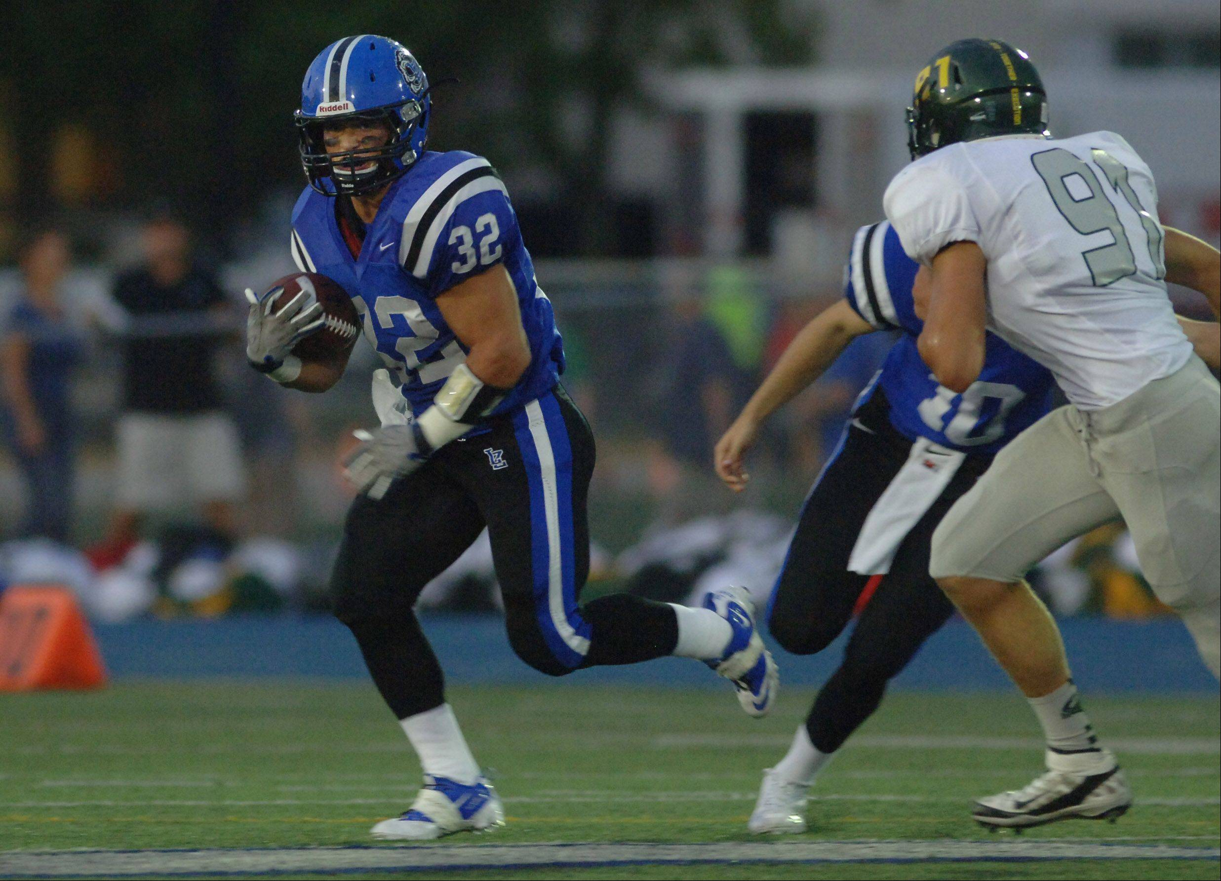 Lake Zurich's Connor Schrader finds running room against Fremd.