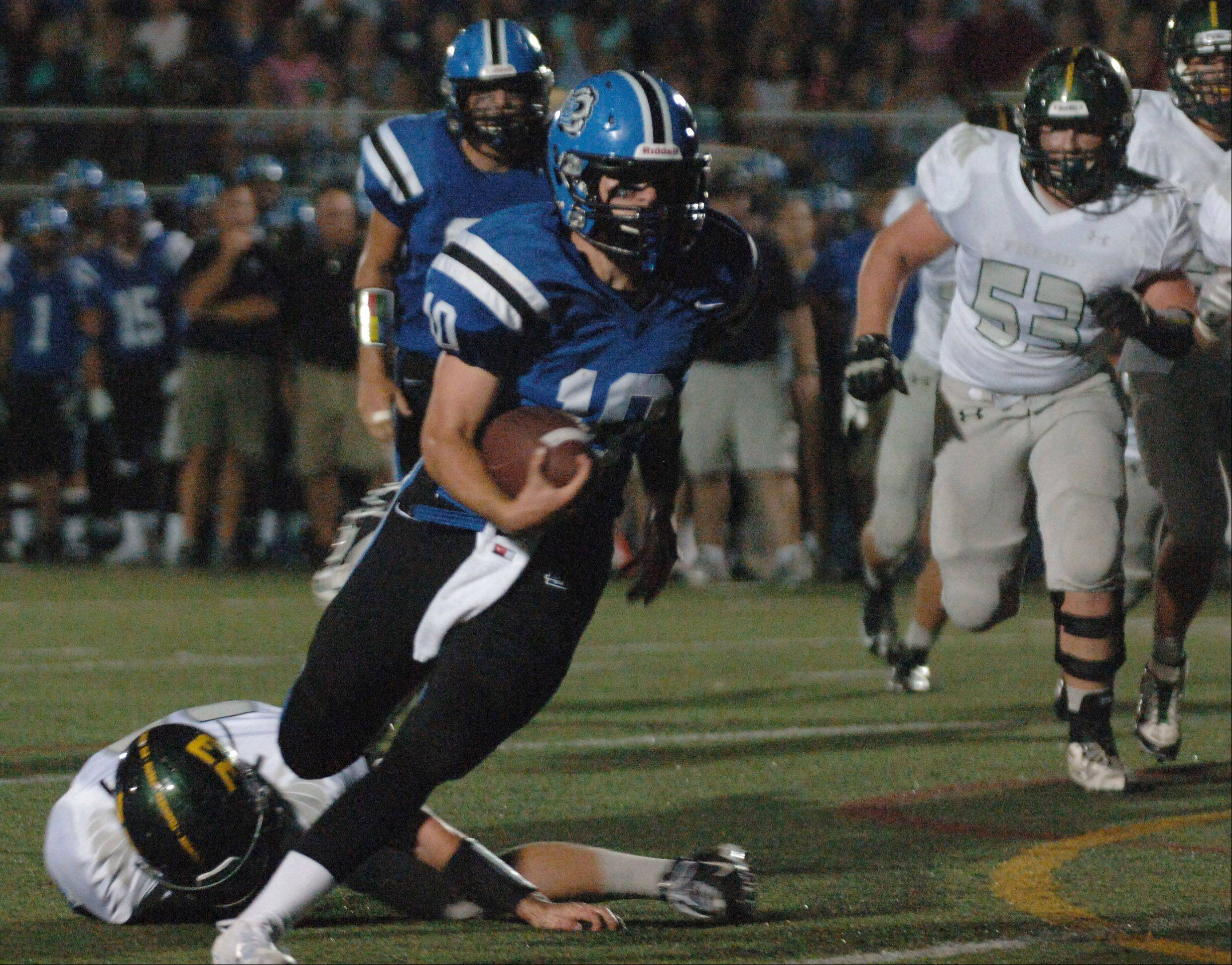 Lake Zurich quarterback Jake Stauner heads into the end zone for a touchdown .
