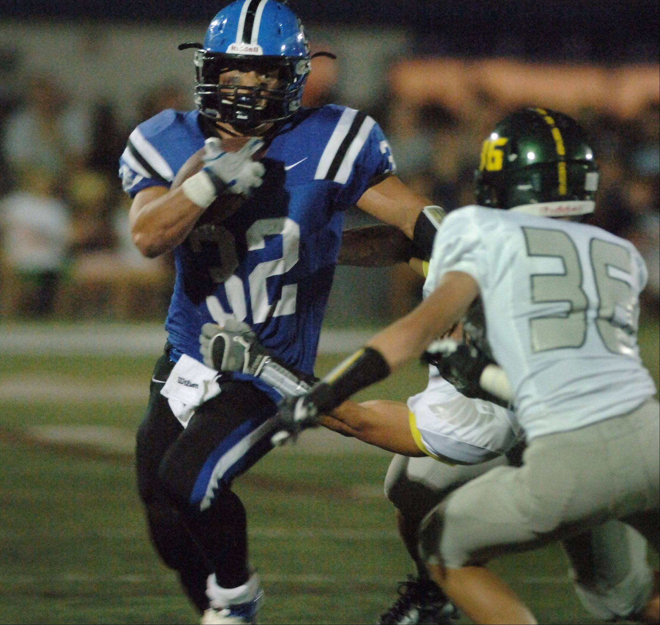 Lake Zurich's Connor Schrader looks for some running room against Fremd.