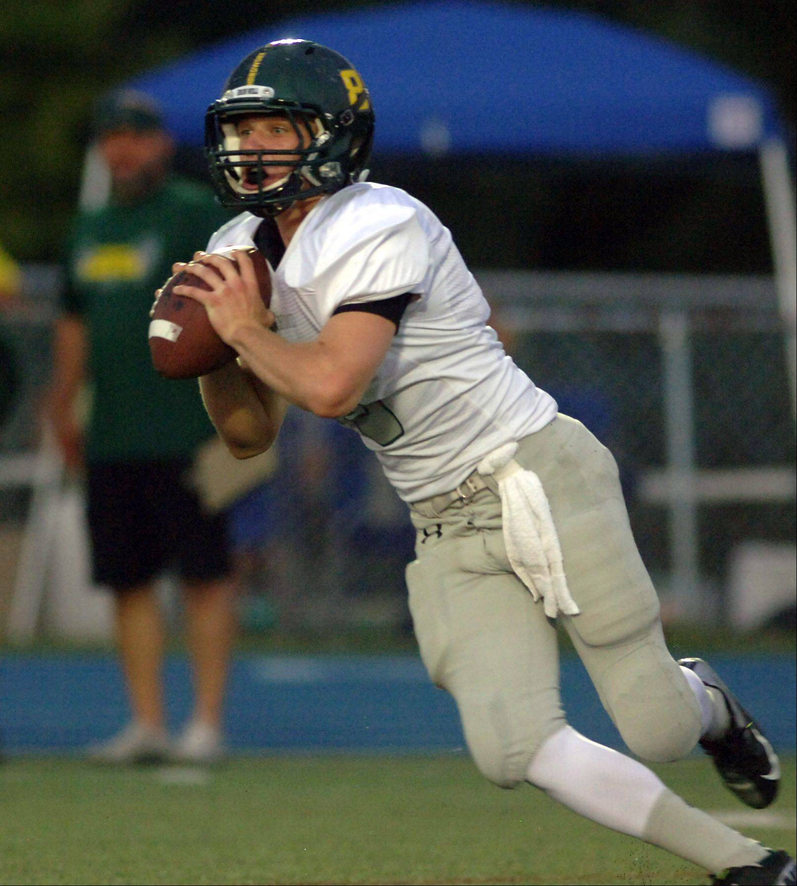 Fremd quarterback Sam Beutler looks for a receiver .