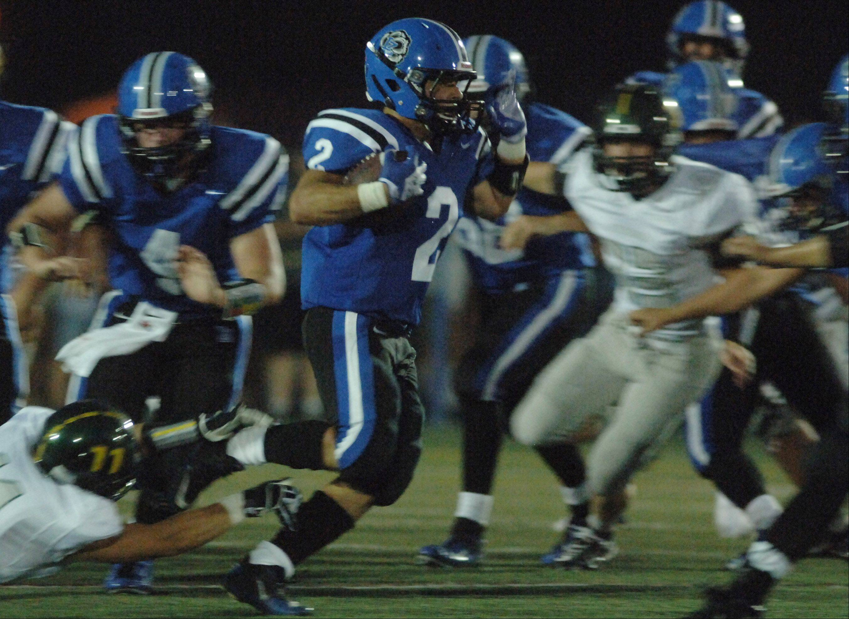 Lake Zurich's Kody Schaar gets some running room against Fremd .