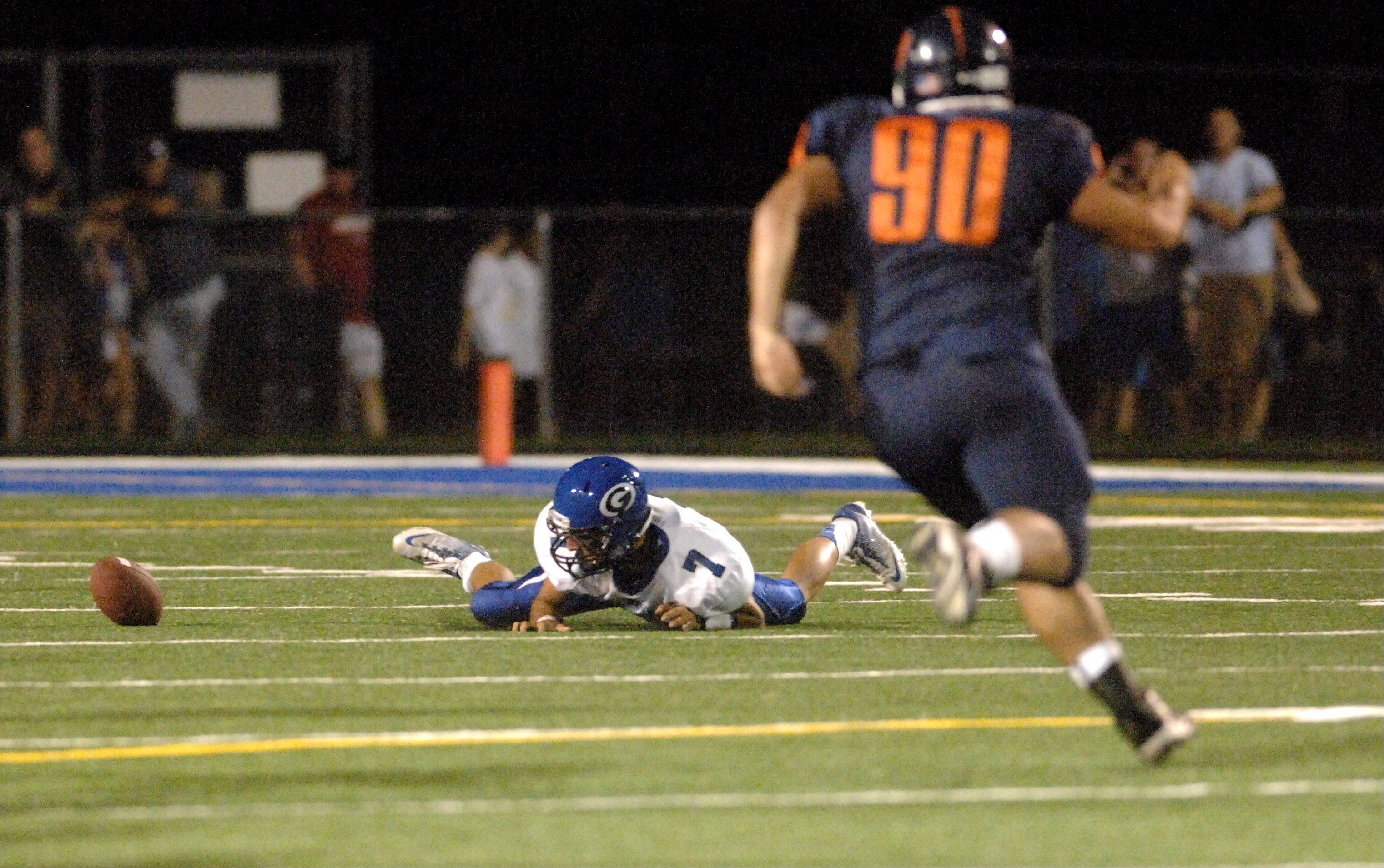 Geneva's Daniel Santacaterina loses the ball after a snap on a punt, one of six first-half fumbles by the Vikings.