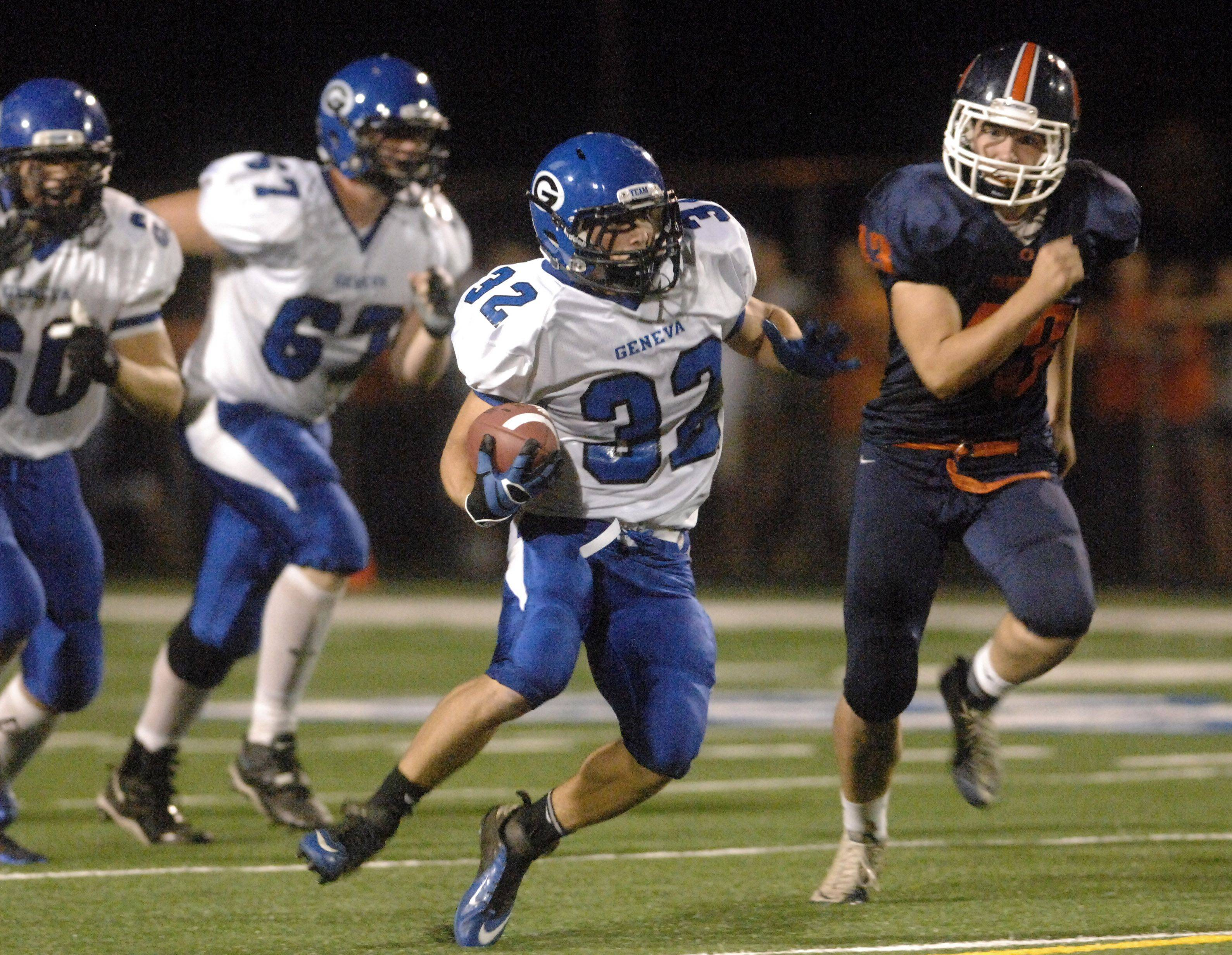 Geneva's Bobby Hess makes a nice gain up the middle against Oswego during Friday's game at Geneva.