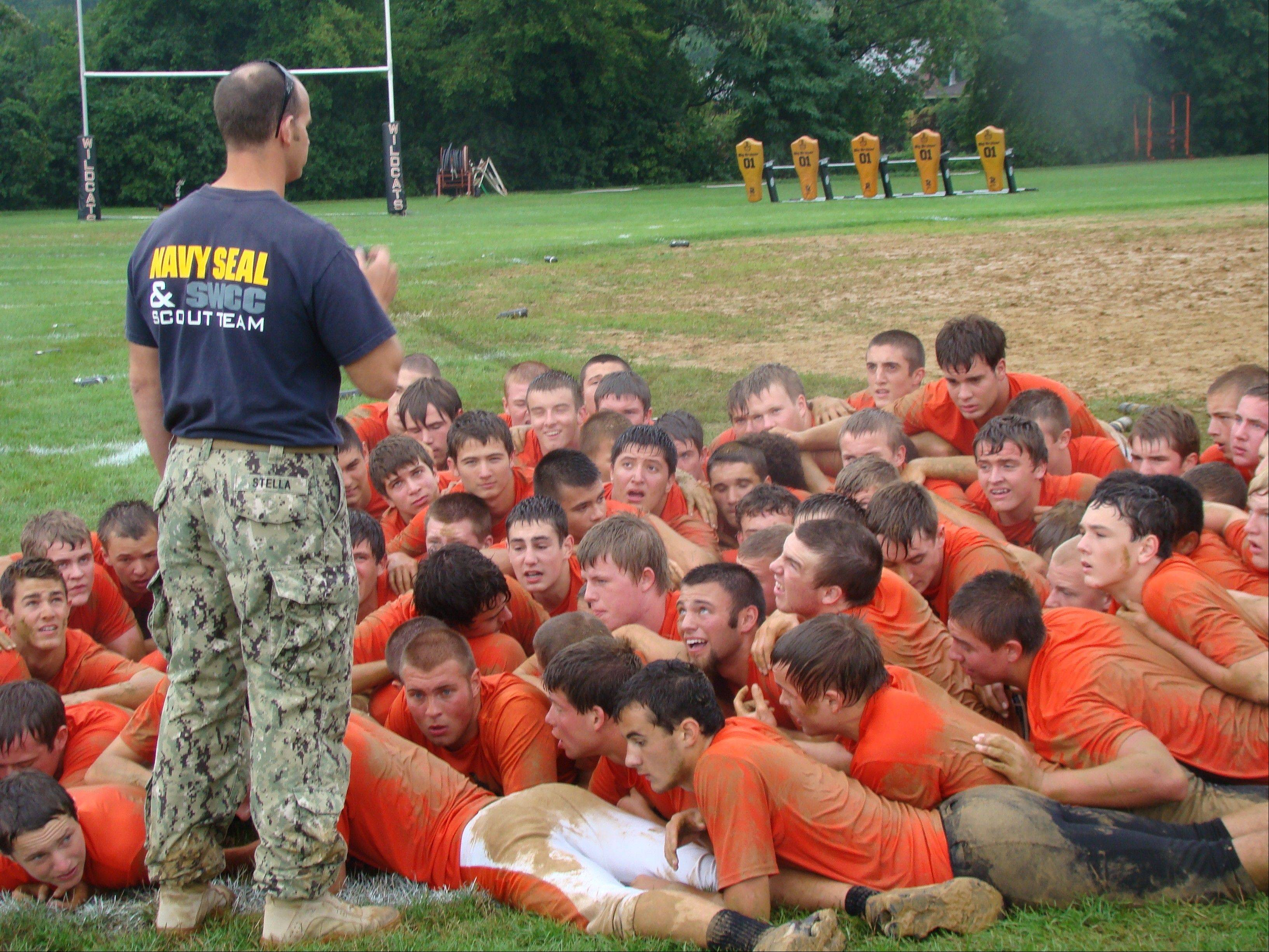 Libertyville's football players band together while getting lessons in overcoming adversity in a mid-August visit from the Navy SEALs.