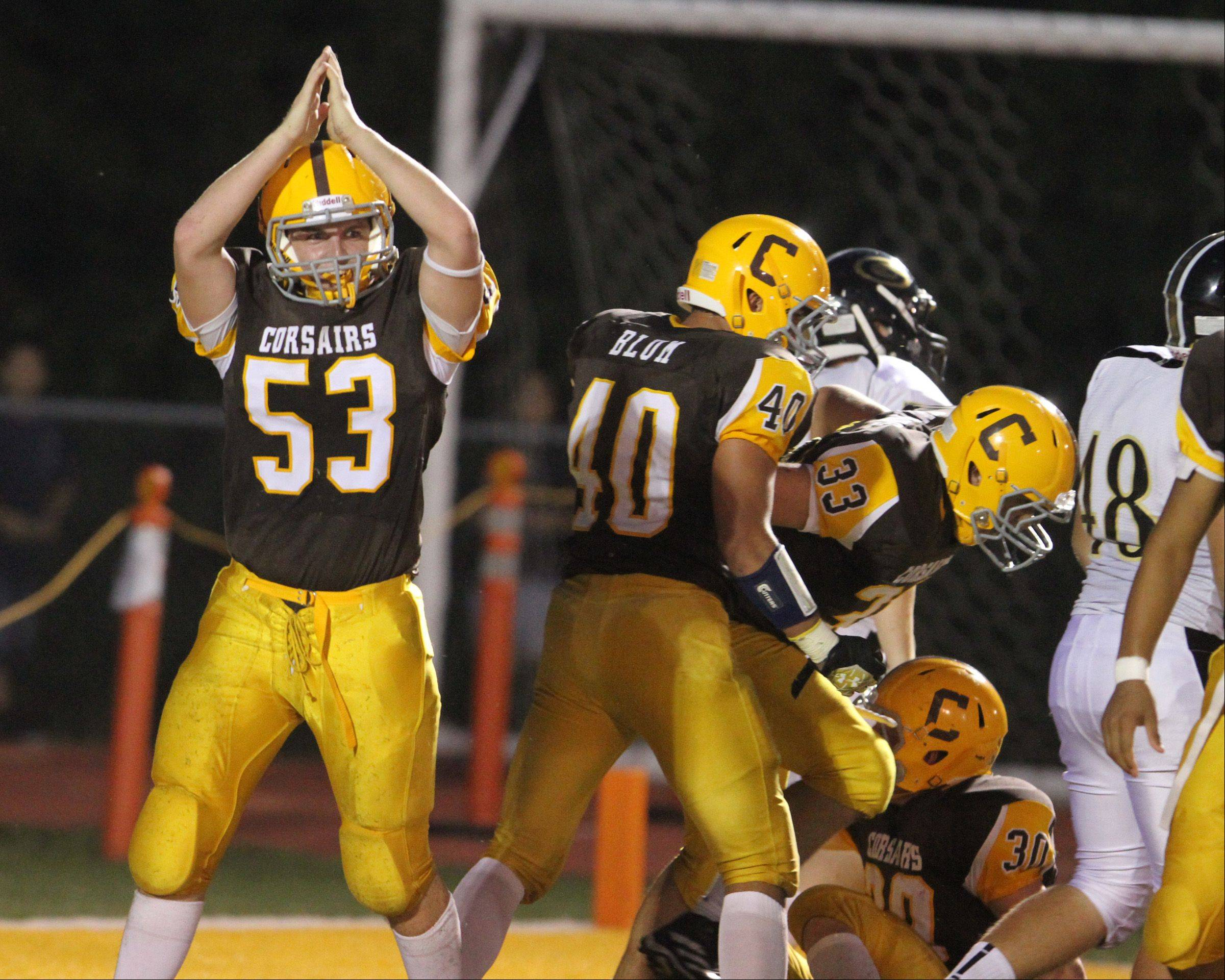 Carmel's Grant Stredler signals a safety against Glenbard North in the first quarter at Carmel on Friday.