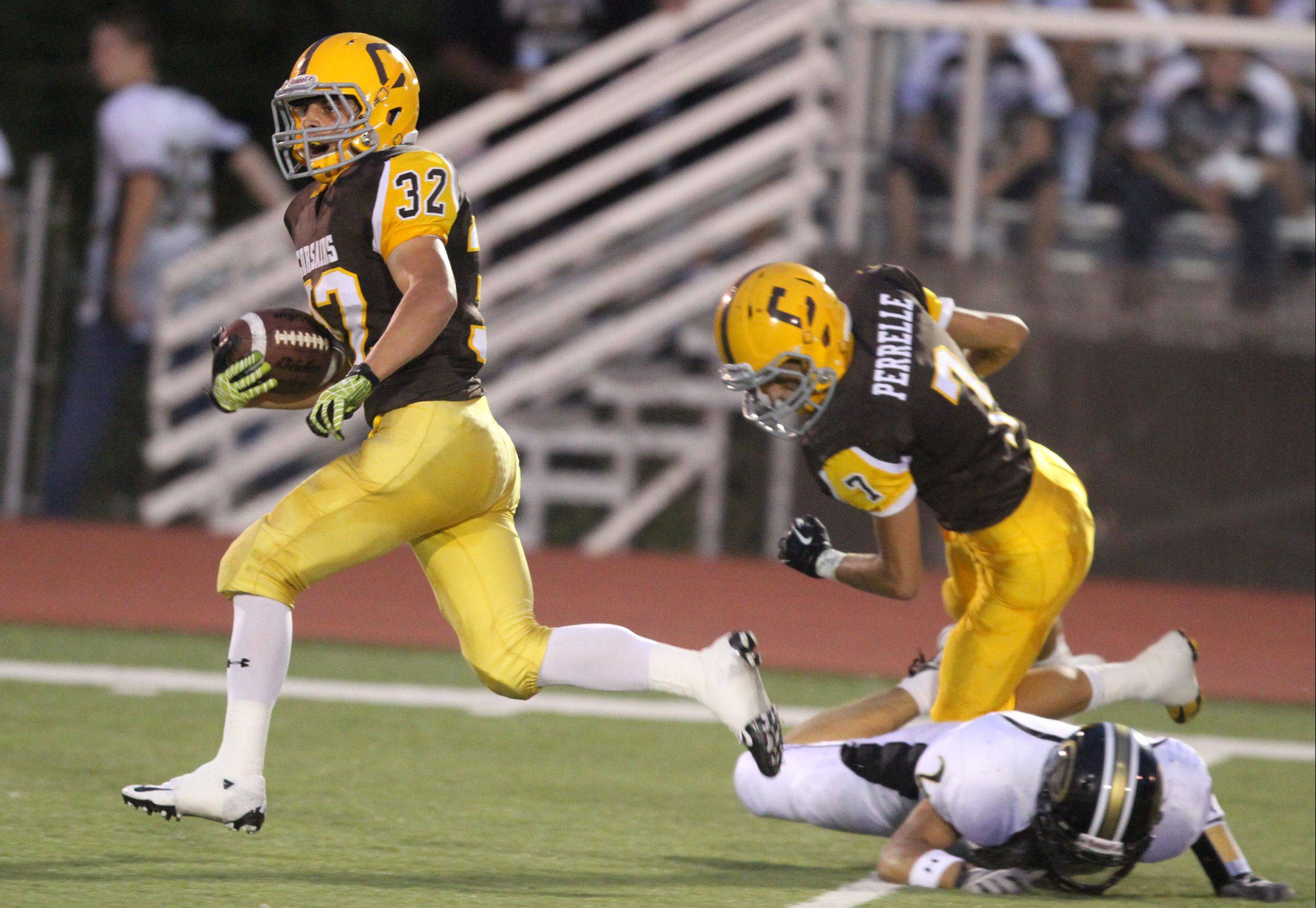 Carmel's Tim Serio scores the first touchdown of the game against Glenbard North at Carmel on Friday.