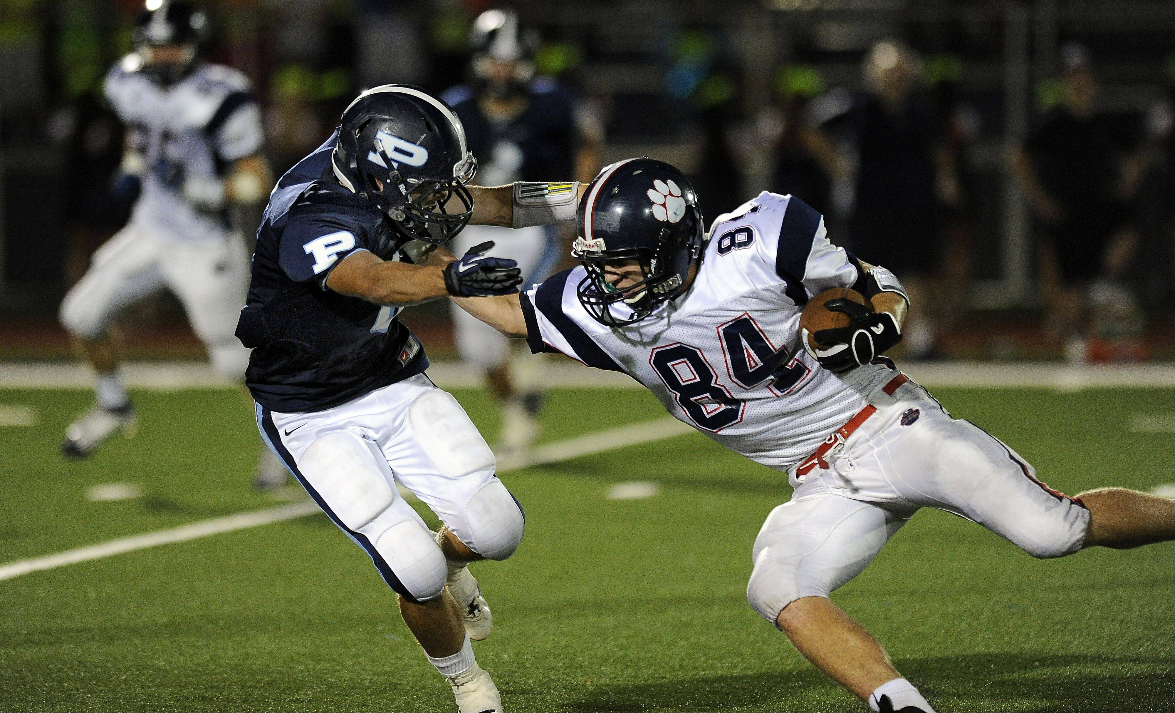 Conant's Tim Manczko turns a pass play into a 21-yard gain as Prospect's Eric Garmoe tries to stop him in the second quarter .