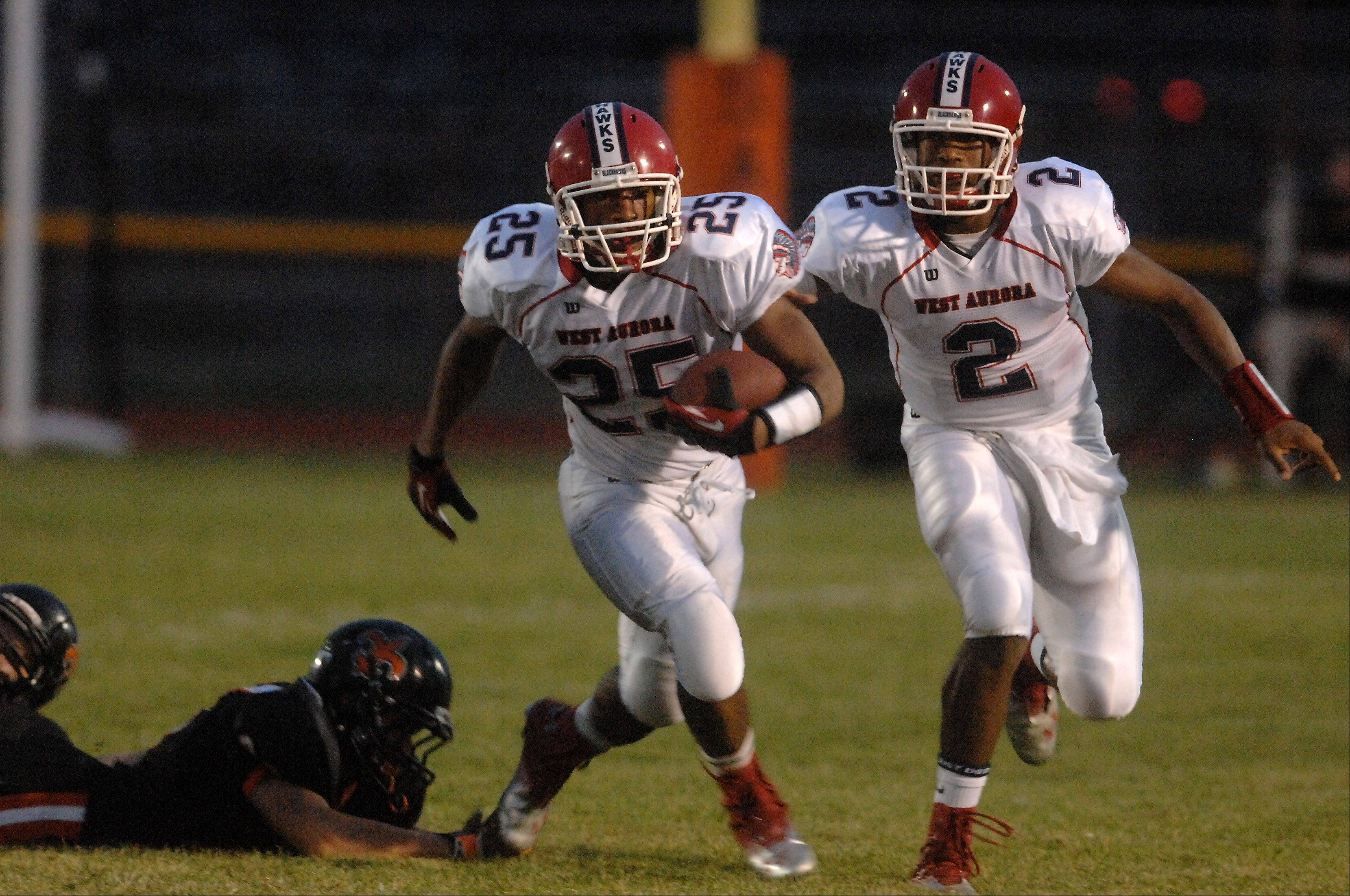 West Aurora's Booker Ross breaks a run to the outside.