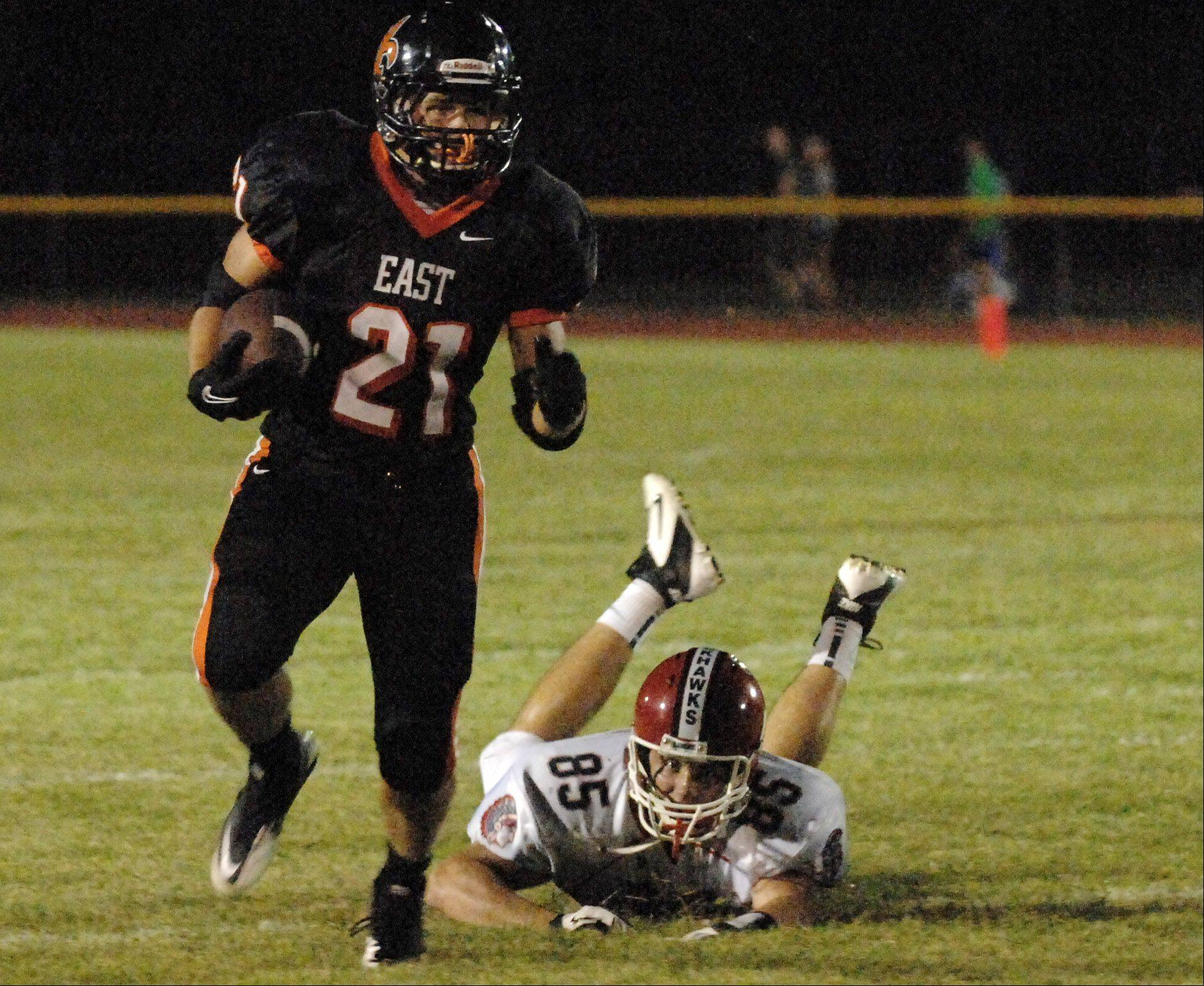 St. Charles East's Erik Anderson gets away from West Aurora's Spencer Thomas.