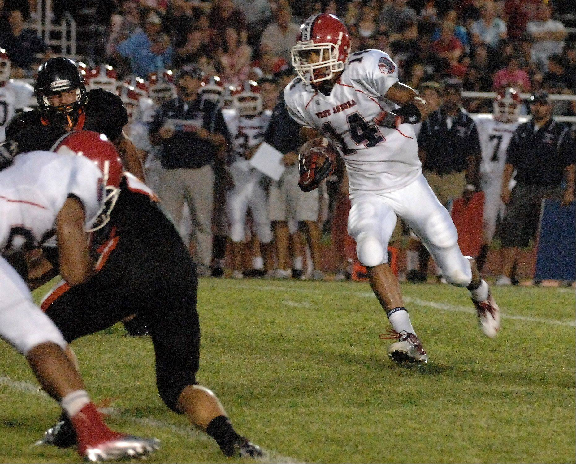 West Aurora's Cole Childs picks up some yards after a reception.