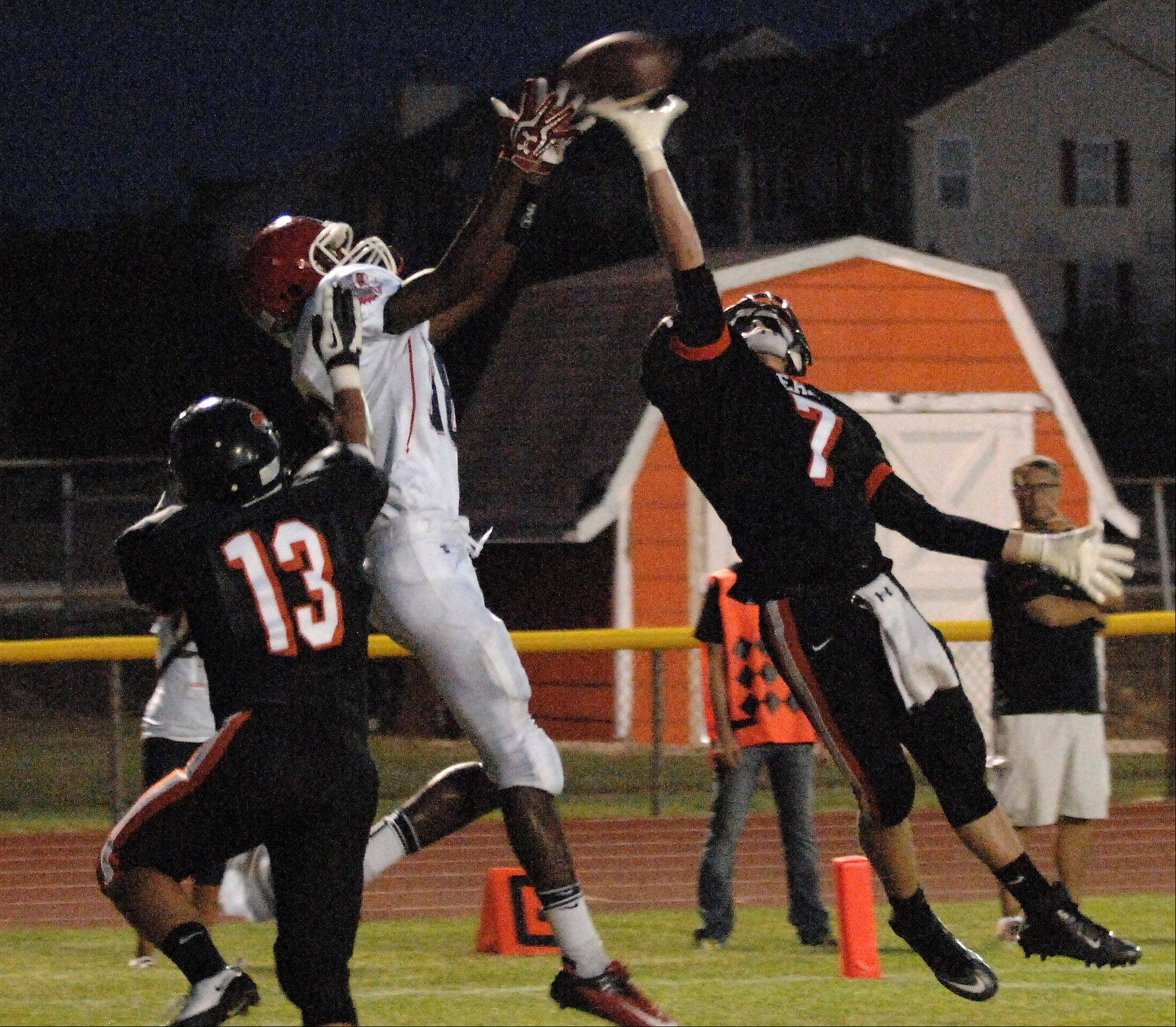 St. Charles East's LJ Rutkowski breaks up a pass in the end zone intended for West Aurora's Aaron Kennebrew.