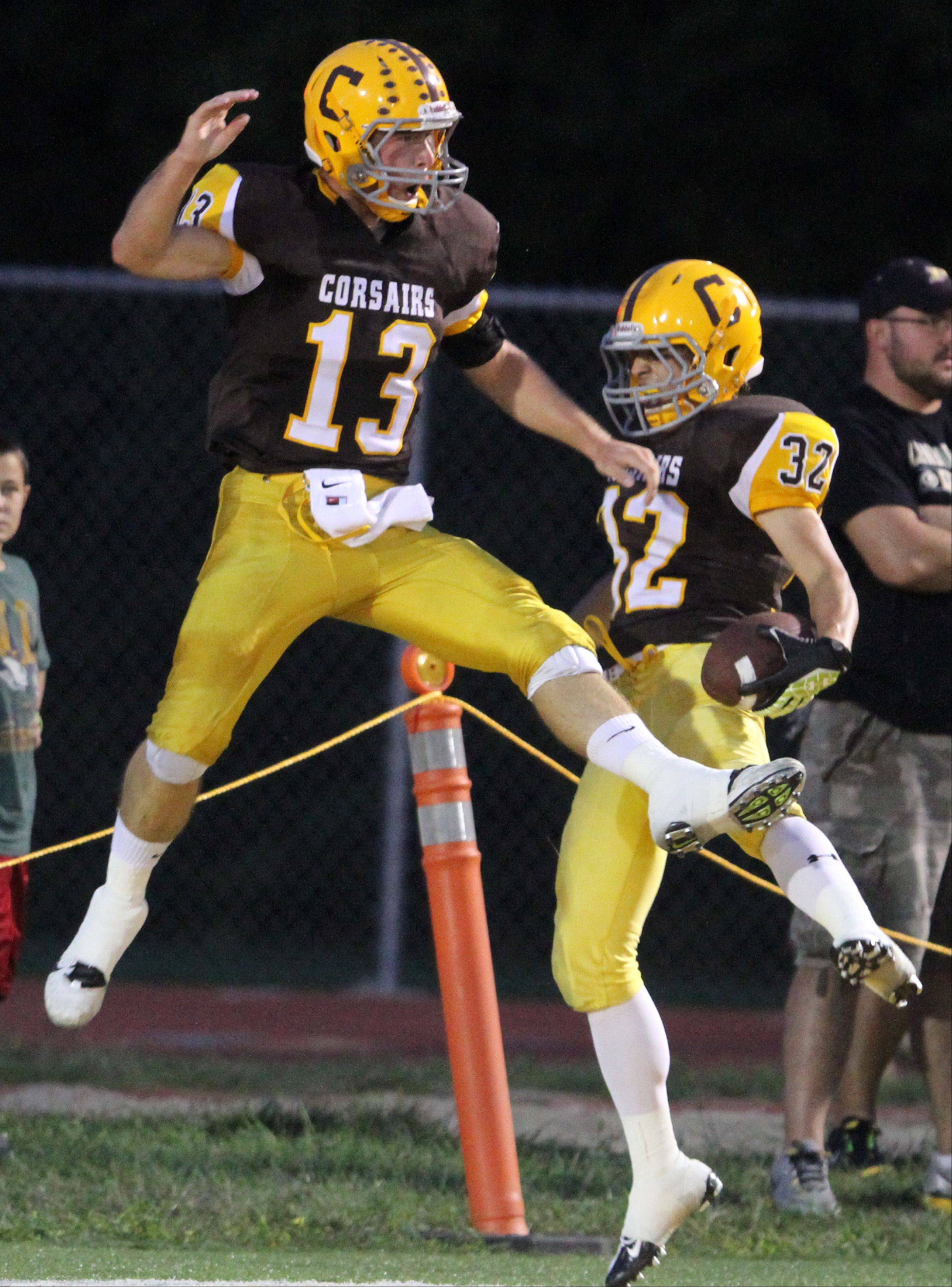 Carmel's Tim Serio, right, and Josh Walinski celebrate Serio scoring the first touchdown of the game .