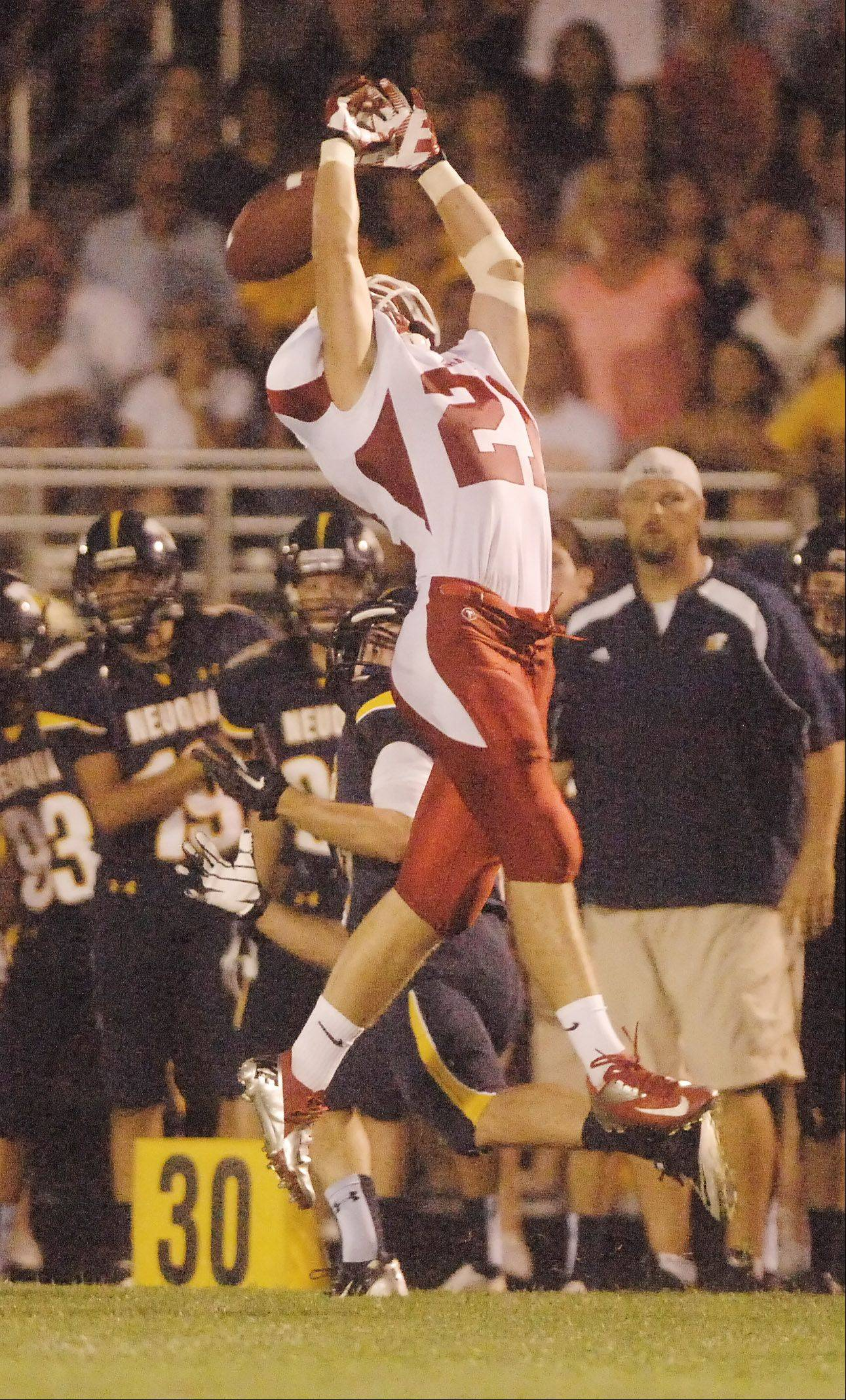 Justin Markham of Naperville Central tries for a pass.