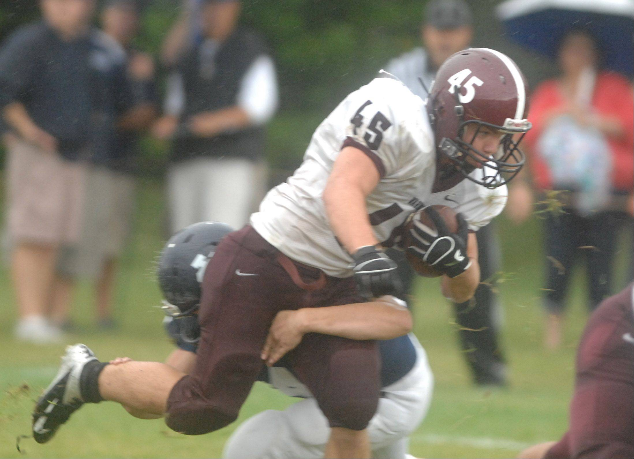 John Gemmel of Wheaton Academy plows through the line during the Wheaton Academy vs. Immaculate Conception game in Elmhurst Saturday.