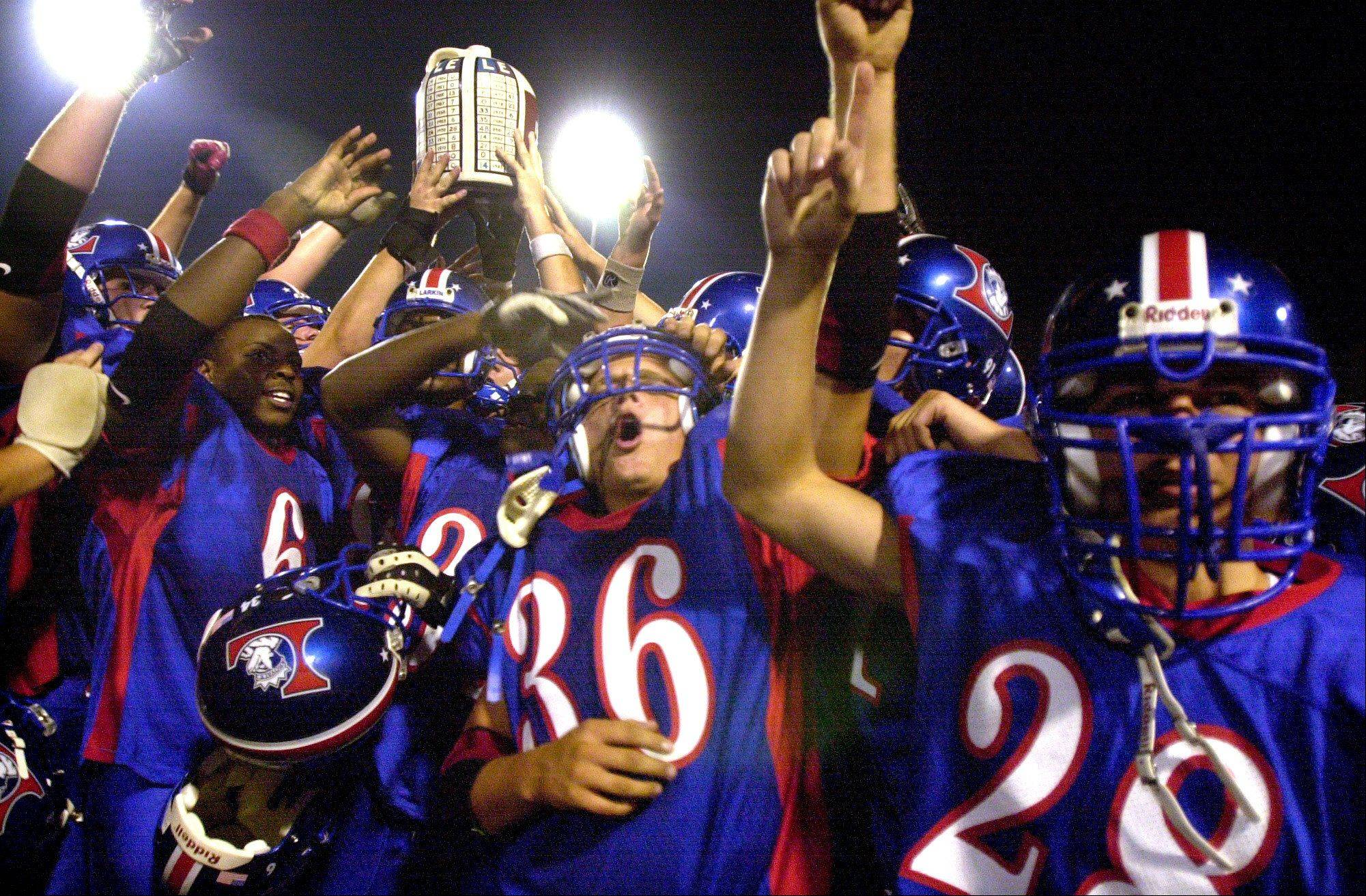 The Larkin Royals hoist the town jug after defeating the Elgin Maroons in this September, 2002 Daily Herald file photo. The Town Jug game returns to Friday night this season for the first time since that 2002 game.