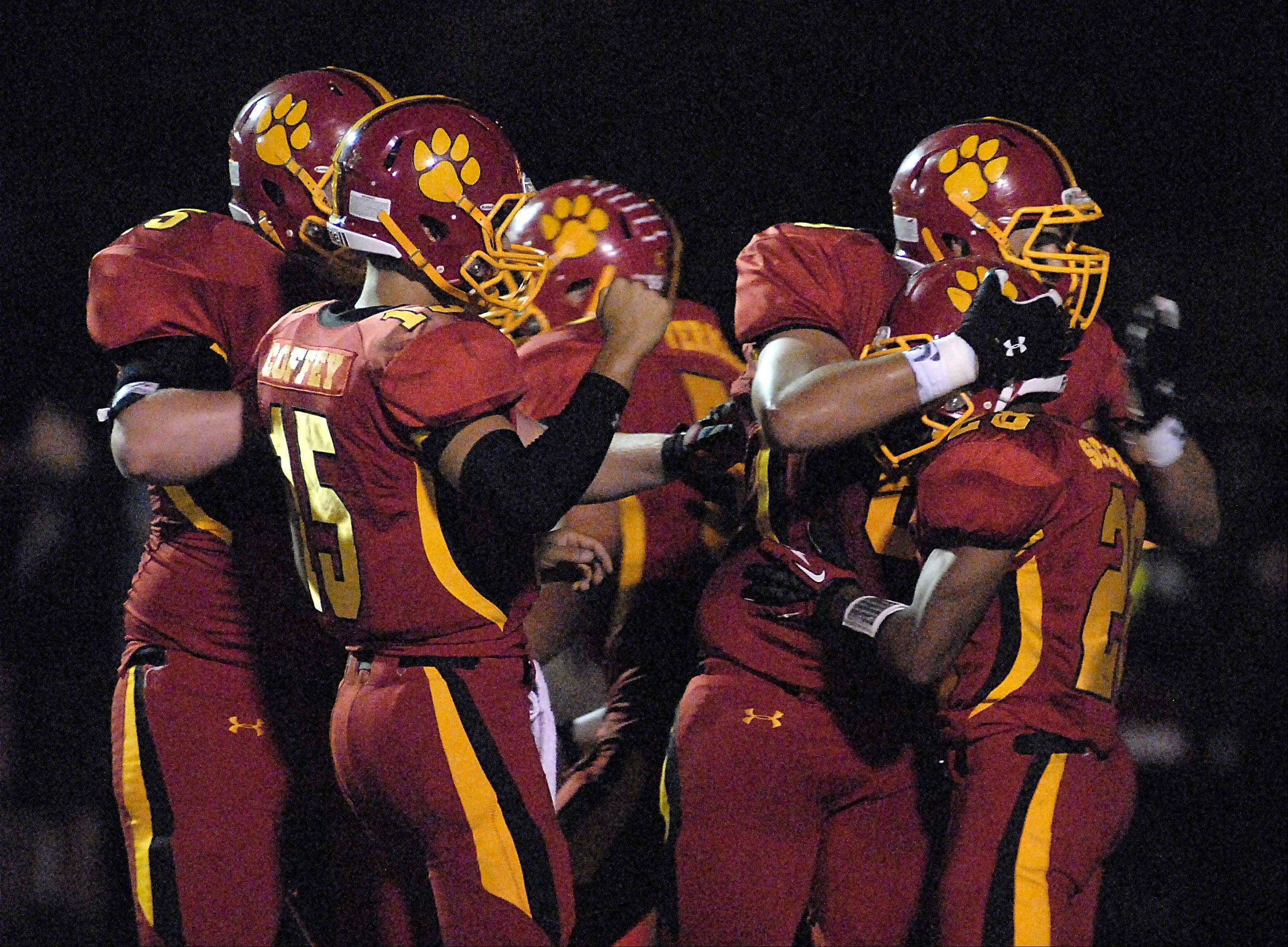 Batavia's Adam Hunger hugs Anthony Scaccia after a second quarter touchdown.